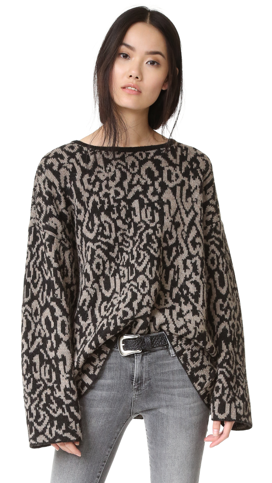 An abstract pattern covers this slouchy, oversized IRO.JEANS sweater. Banded neckline. Dropped shoulder seams and loose long sleeves. Fabric: Knit. 45% acrylic/40% alpaca/15% wool. Hand wash or dry clean. Made in Italy. Measurements Length: 25.5in / 65cm,