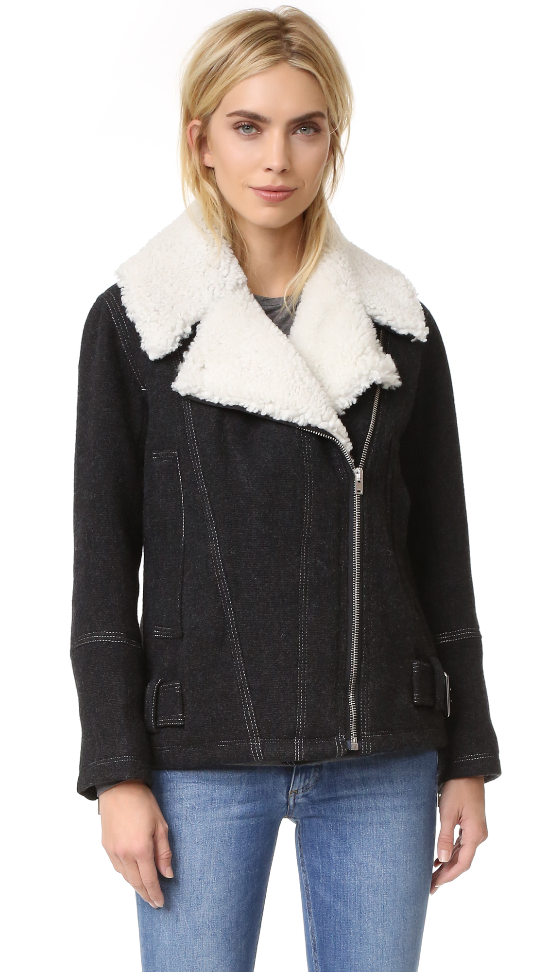 Plush shearling lapels bring cozy style to this IRO moto jacket. Off center zip placket and hidden zip front pockets. Buckle tabs at hem. Zip cuffs. Lined. Fur: Dyed shearling (sheep), from Turkey. Fabric: Woven wool.
