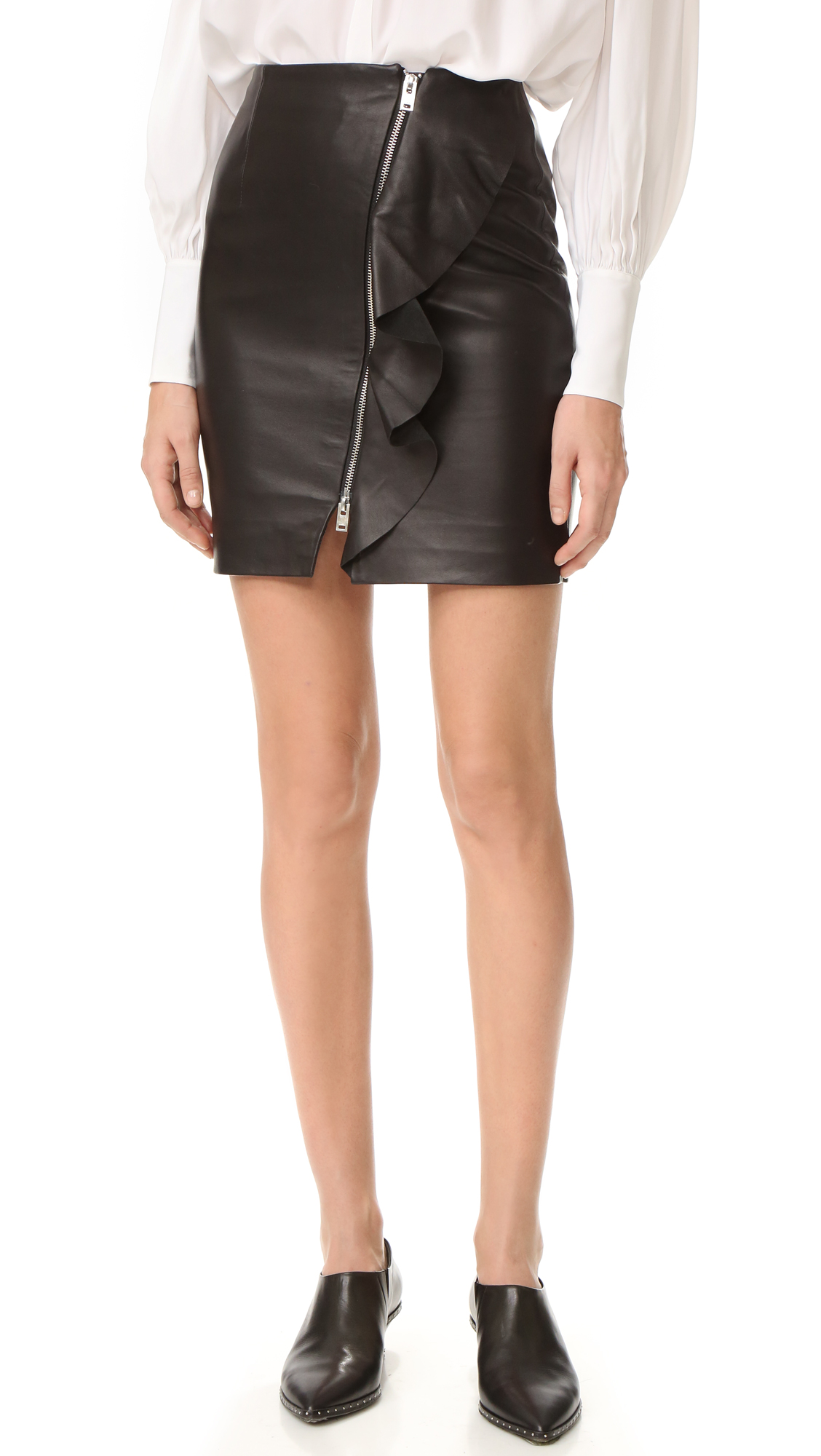 A flounced ruffle runs along the exposed two way zip on this luxe leather IRO skirt. Lined. Fabric: Leather. Shell: 100% lambskin. Lining: 53% polyester/47% viscose. Leather clean. Imported, China. Measurements Length: 17.75in / 45cm Measurements from size 36. Available
