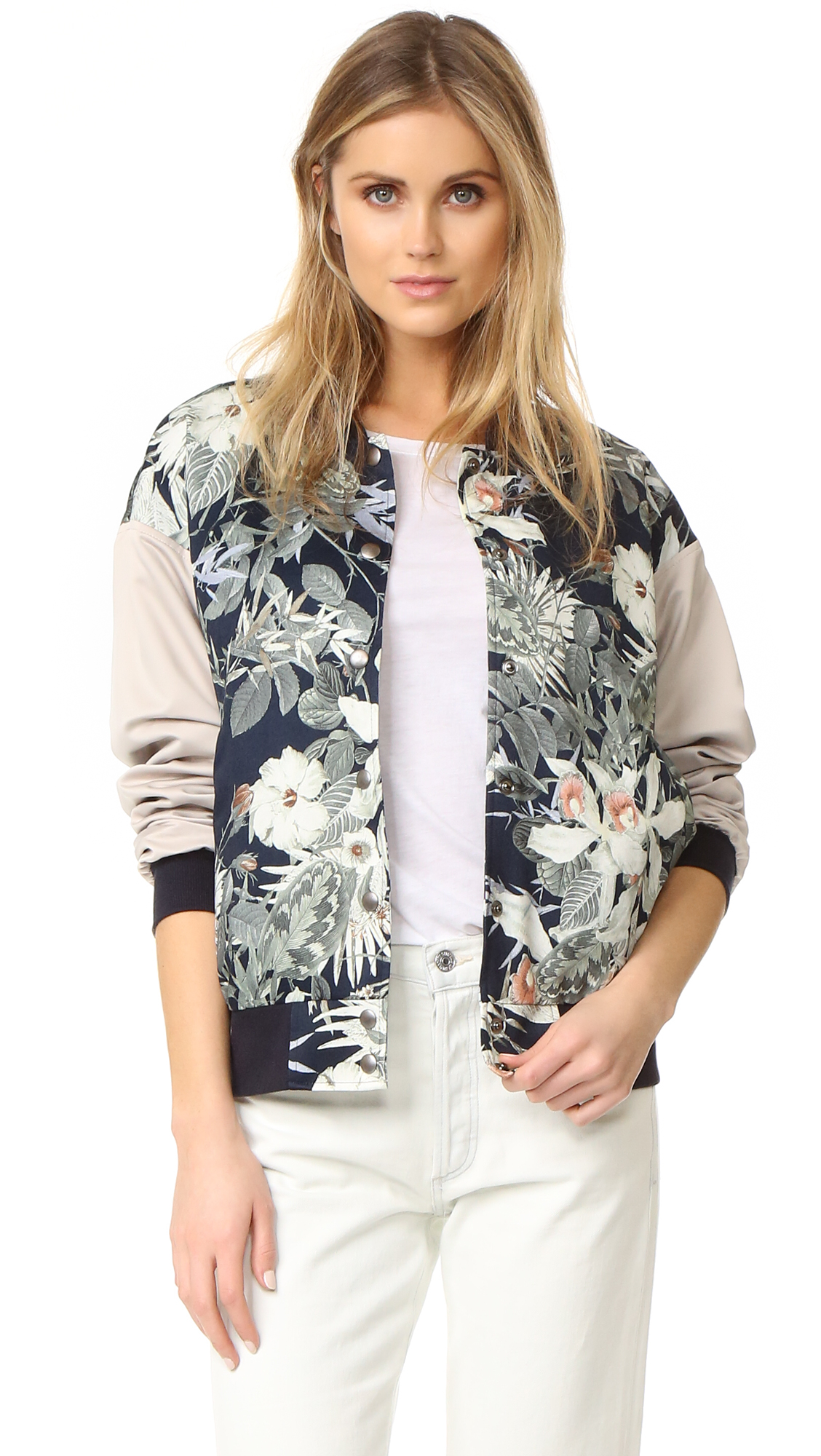 A satin James Jeans bomber jacket with a floral print and contrast sleeves. Snap placket and welt front pockets. Ribbed edges. Lined. Fabric: Satin. 100% polyester. Dry clean. Made in the USA. Measurements Length: 24.5in / 62cm, from