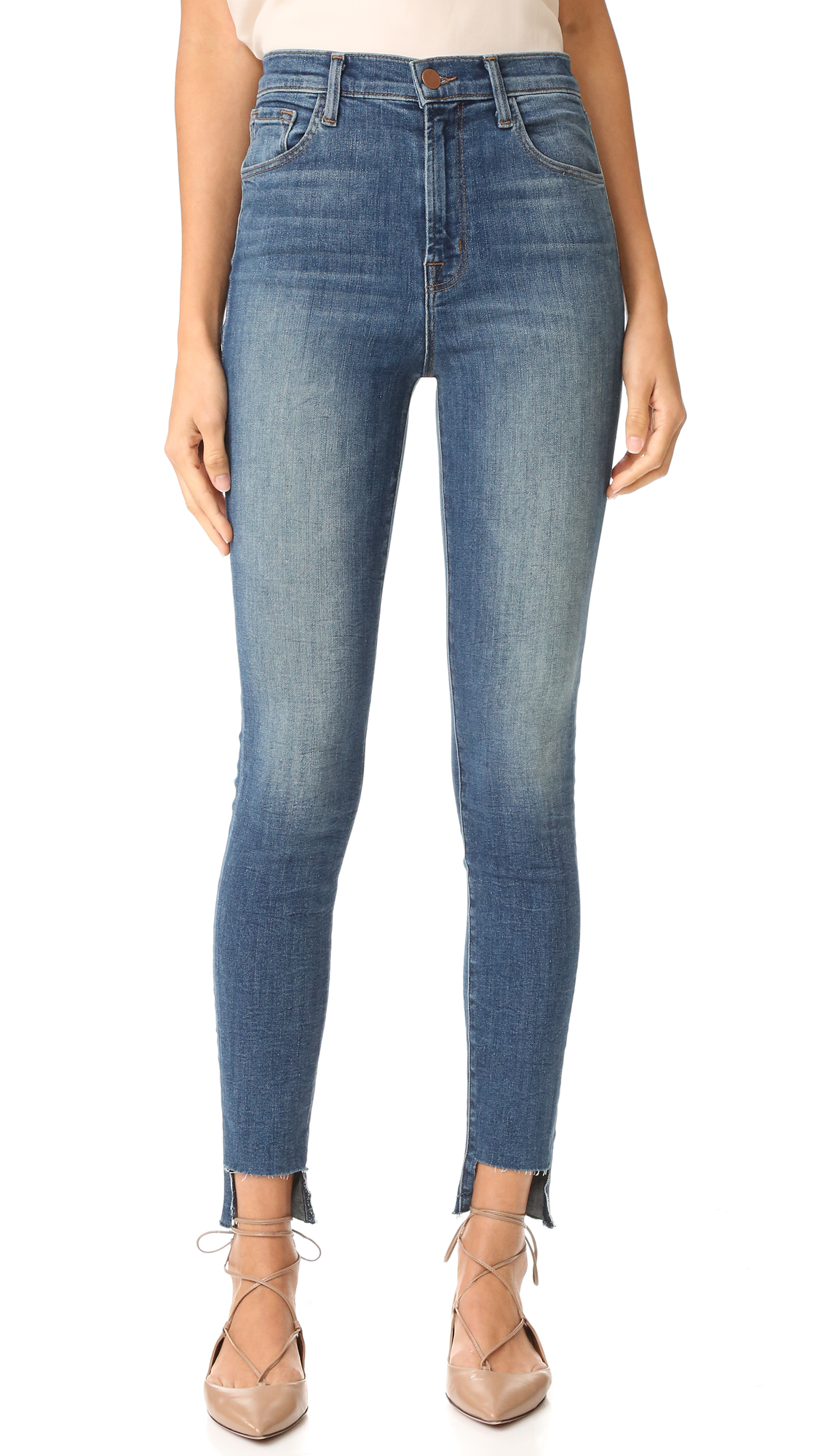 High waisted McGuire Denim skinny jeans. The frayed, cutout hem creates an undone finish. 5 pocket styling. Button closure and zip fly. Fabric: Lightweight stretch denim. 93% cotton/5% polyester/2% elastane. Wash cold. Made in the USA. Imported materials.