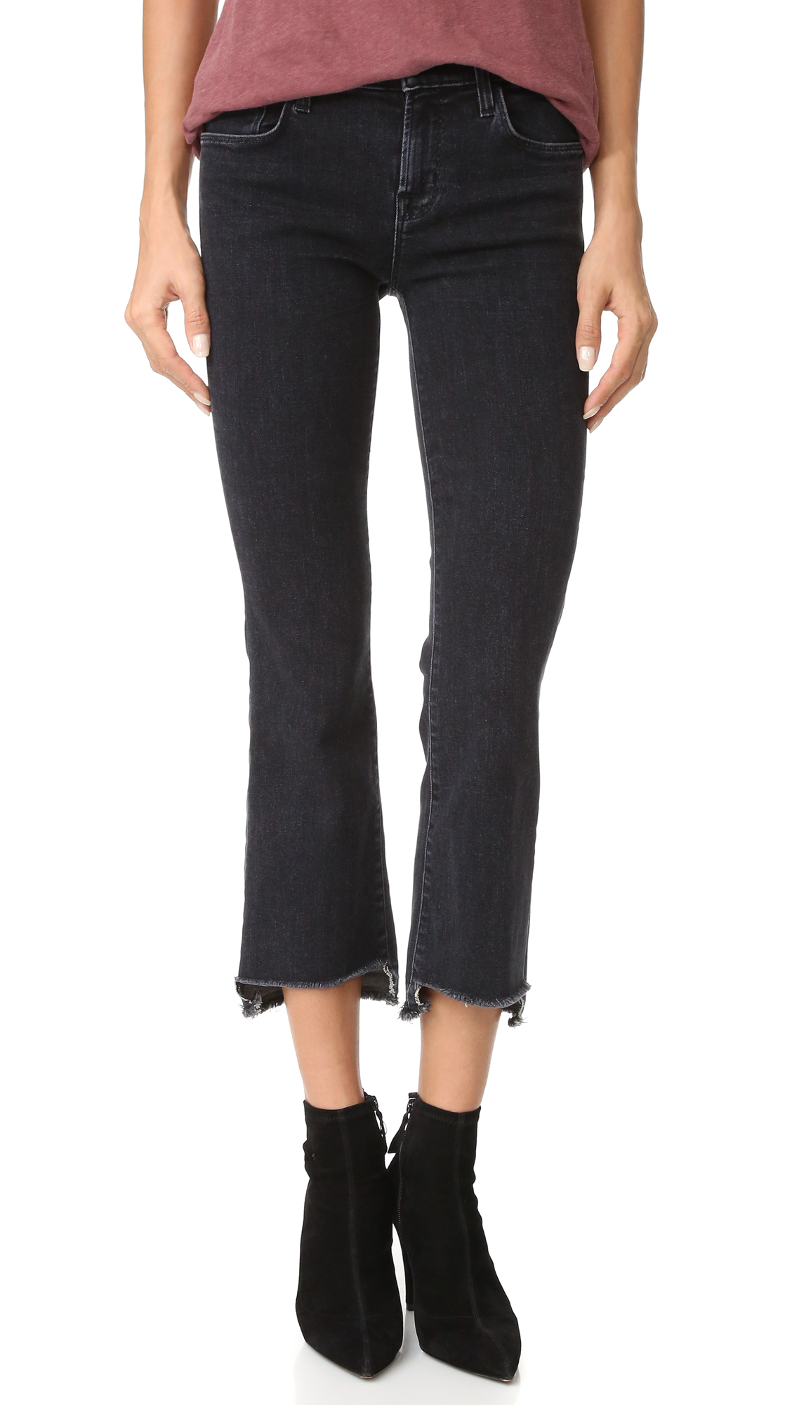 Raw, notched hems lend a hand cropped look to these formfitting J Brand jeans. 5 pocket styling. Button closure and zip fly. Fabric: Stretch denim. 92% cotton/6% elastomultiester/2% elastane. Wash cold. Made in the USA. Imported materials. Measurements
