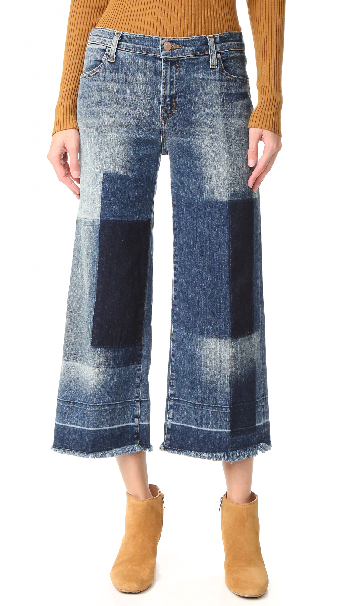 A variety of washes create a patchwork effect on these J Brand culotte jeans. Raw edges at the undone cuffs. 4 pocket styling. Button closure and zip fly. Fabric: Stretch denim. 98% cotton/2% polyurethane. Wash cold. Made in