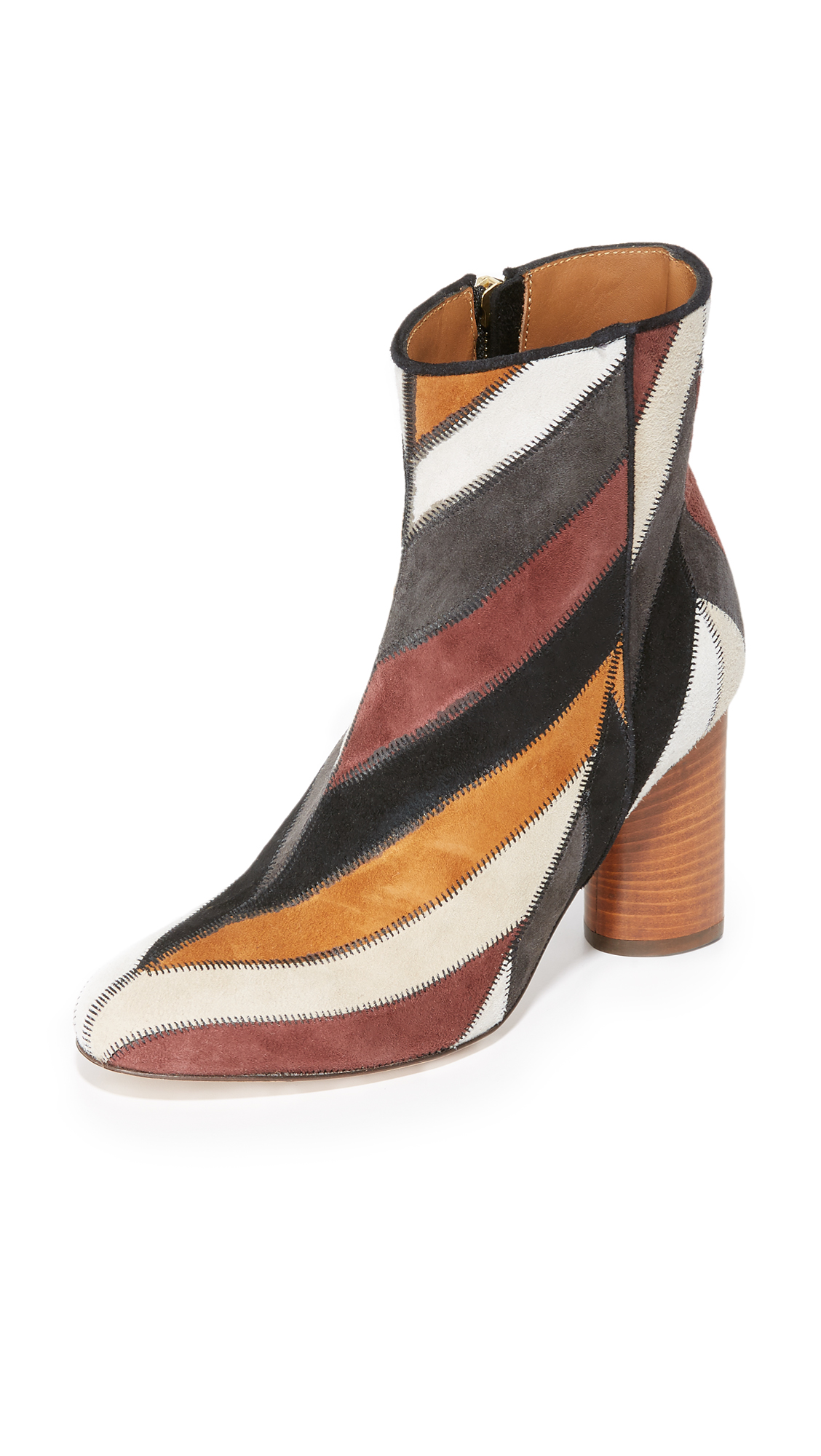 Sophisticated Jerome Dreyfuss booties composed of chevron patches of multi colored suede. Hidden side zip. Inset stacked heel and leather sole. Leather: Goatskin. Made in France. This item cannot be gift boxed. Measurements Heel: 3in / 75mm.