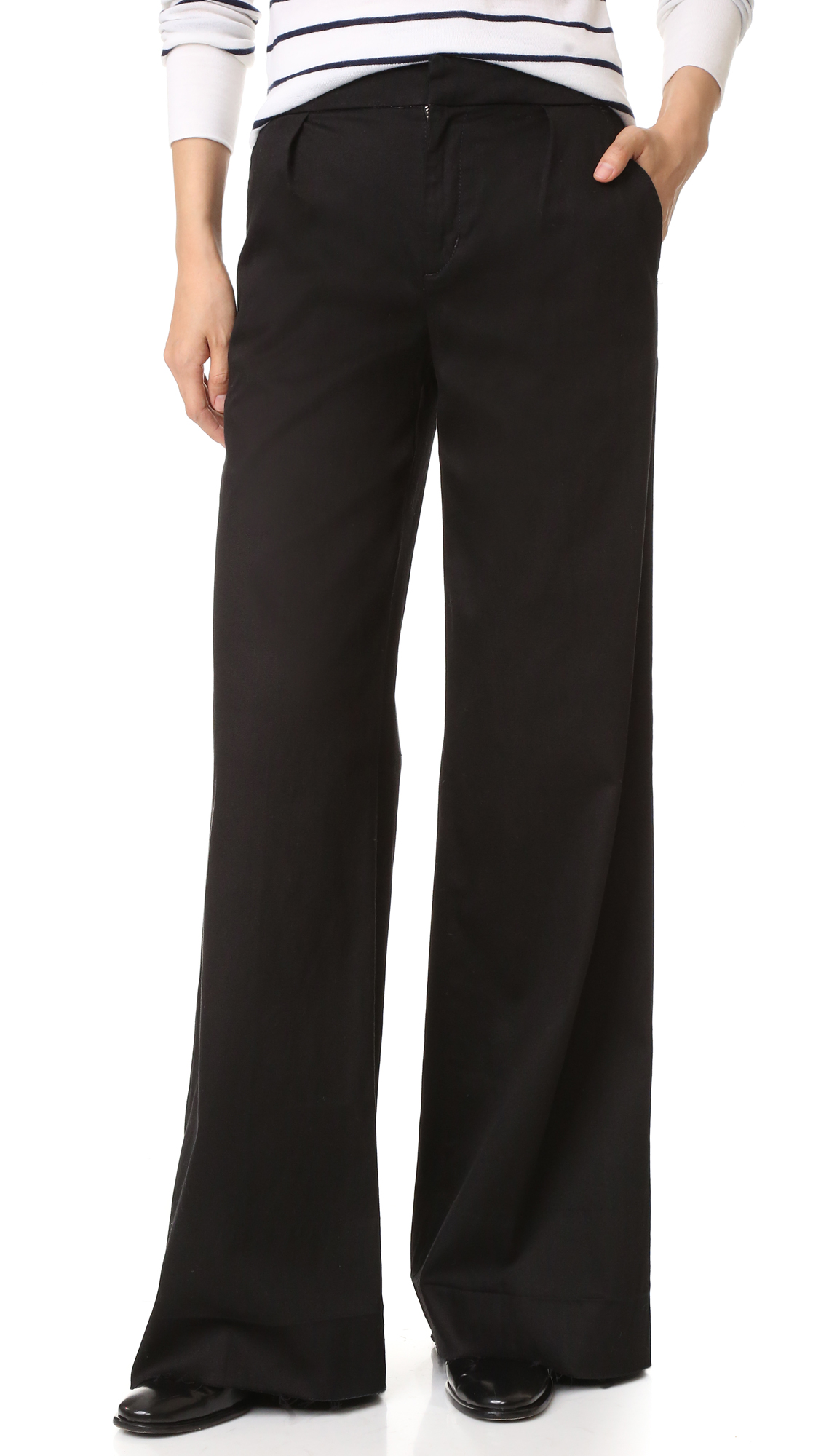 Raw, undone hems lend a deconstructed feel to these pleated Joe's Jeans trousers. The wide leg silhouette is styled with a high rise and cut from super stretch twill. Slant hip pockets. Covered snap closure and