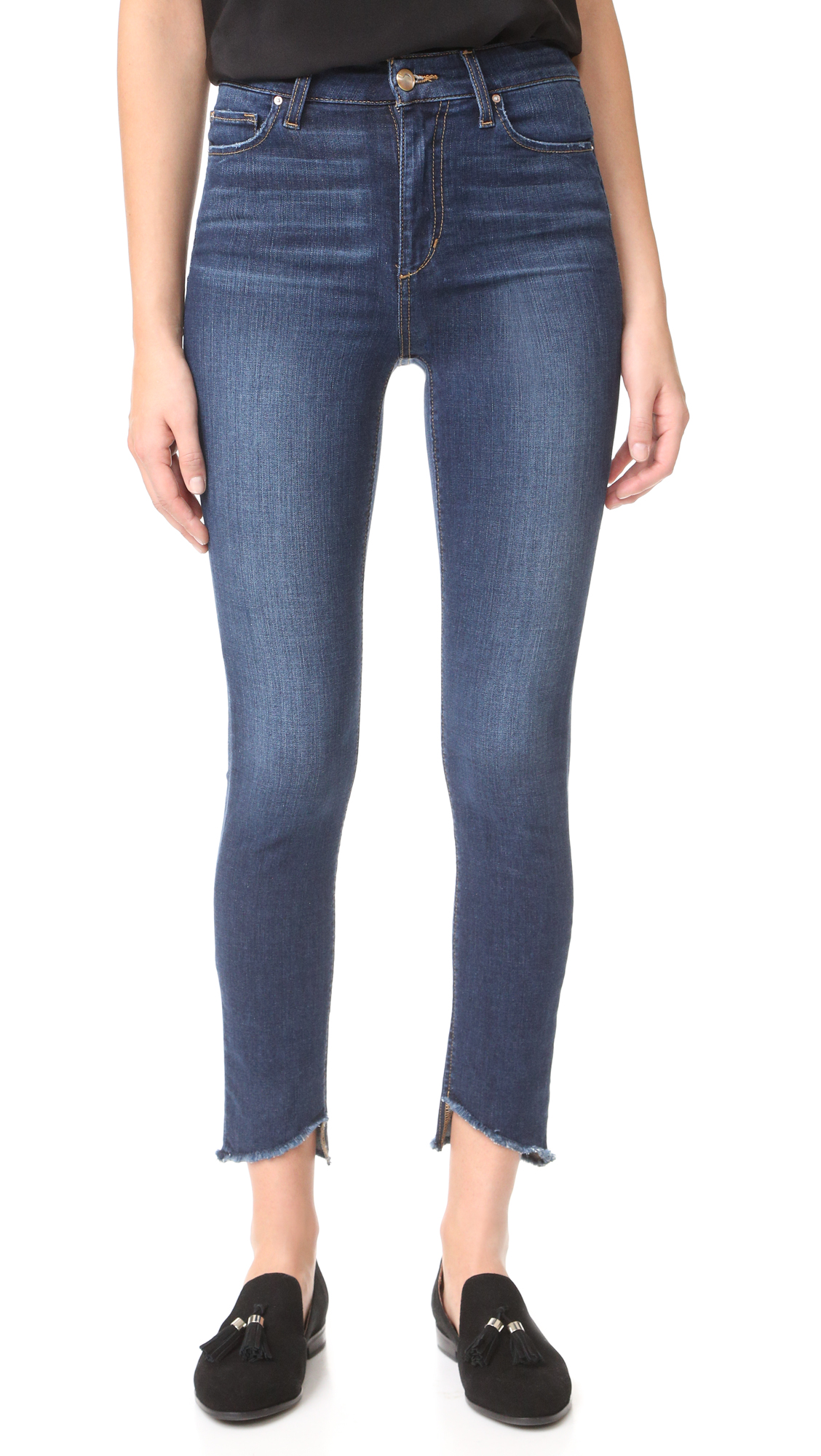 Joe's skinny jeans with frayed, uneven cuffs. 5 pocket styling. Button closure and zip fly. Fabric: Stretch denim. 75% cotton/16% lyocell/6% elasterell p/3% elastane. Wash cold or dry clean. Imported, Mexico. Measurements Rise: 10.75in / 27cm Inseam: 28in / 71cm