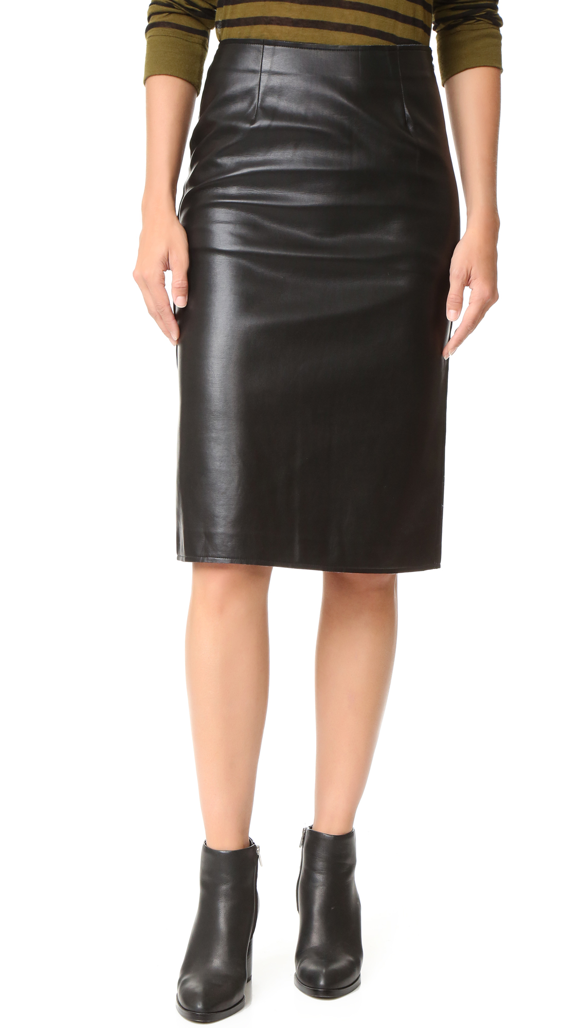 A J.O.A. skirt made from slick faux leather. Back slit. Side zip. Lined. Fabric: Faux leather. Shell: 100% PVC. Lining: 100% polyester. Dry clean. Imported, China. Measurements Length: 26in / 66cm Measurements from size S. Available sizes: