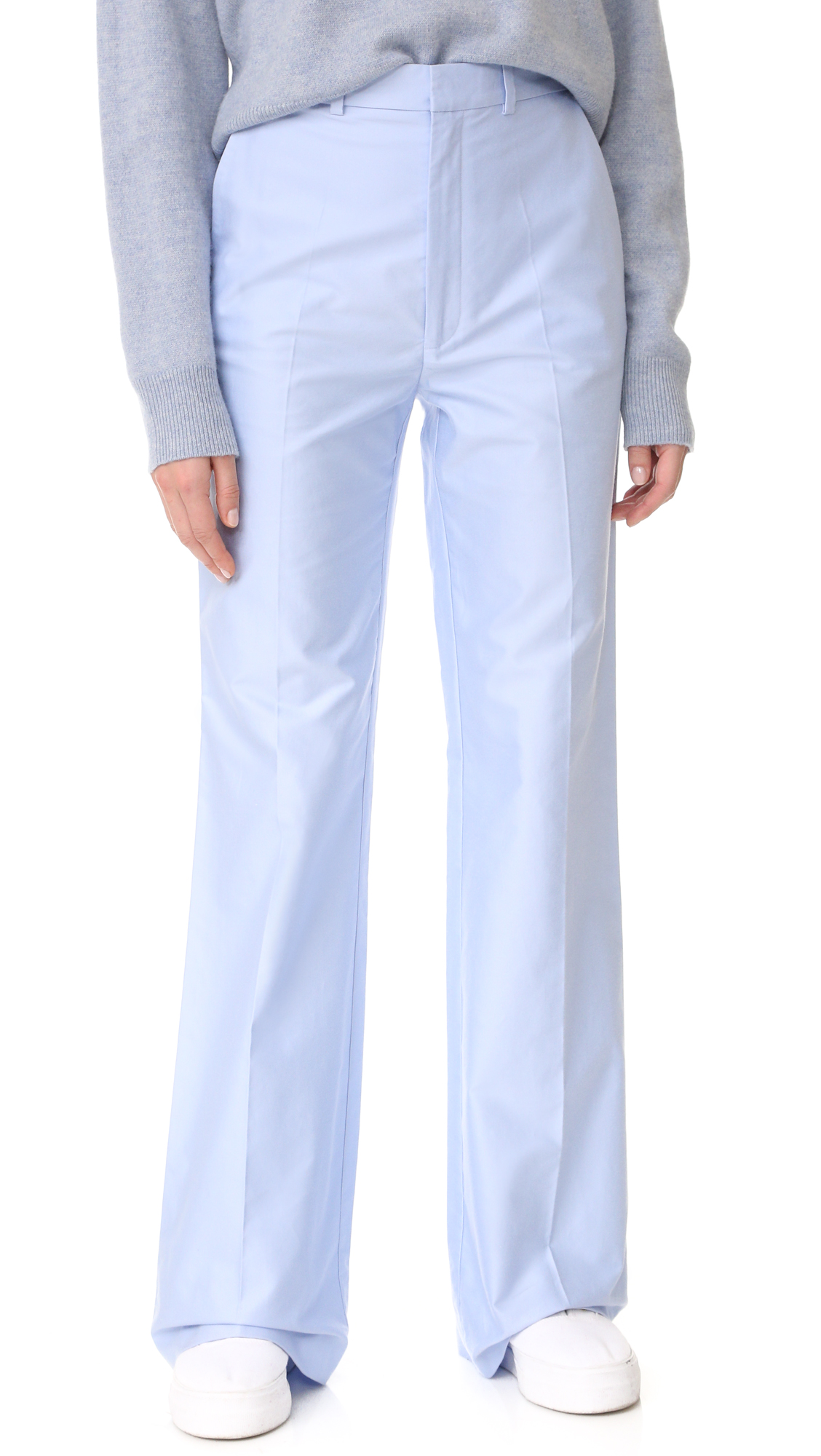 These pastel Joseph wide leg trousers have a clean lined, preppy feel. Slant hip pockets and welt back pocket. Hook and eye closure and zip fly. Fabric: Mid weight suiting. 100% cotton. Hand wash or dry clean.