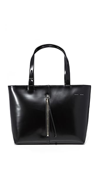 KARA Polished Panel Small Zip Top Tote In Black