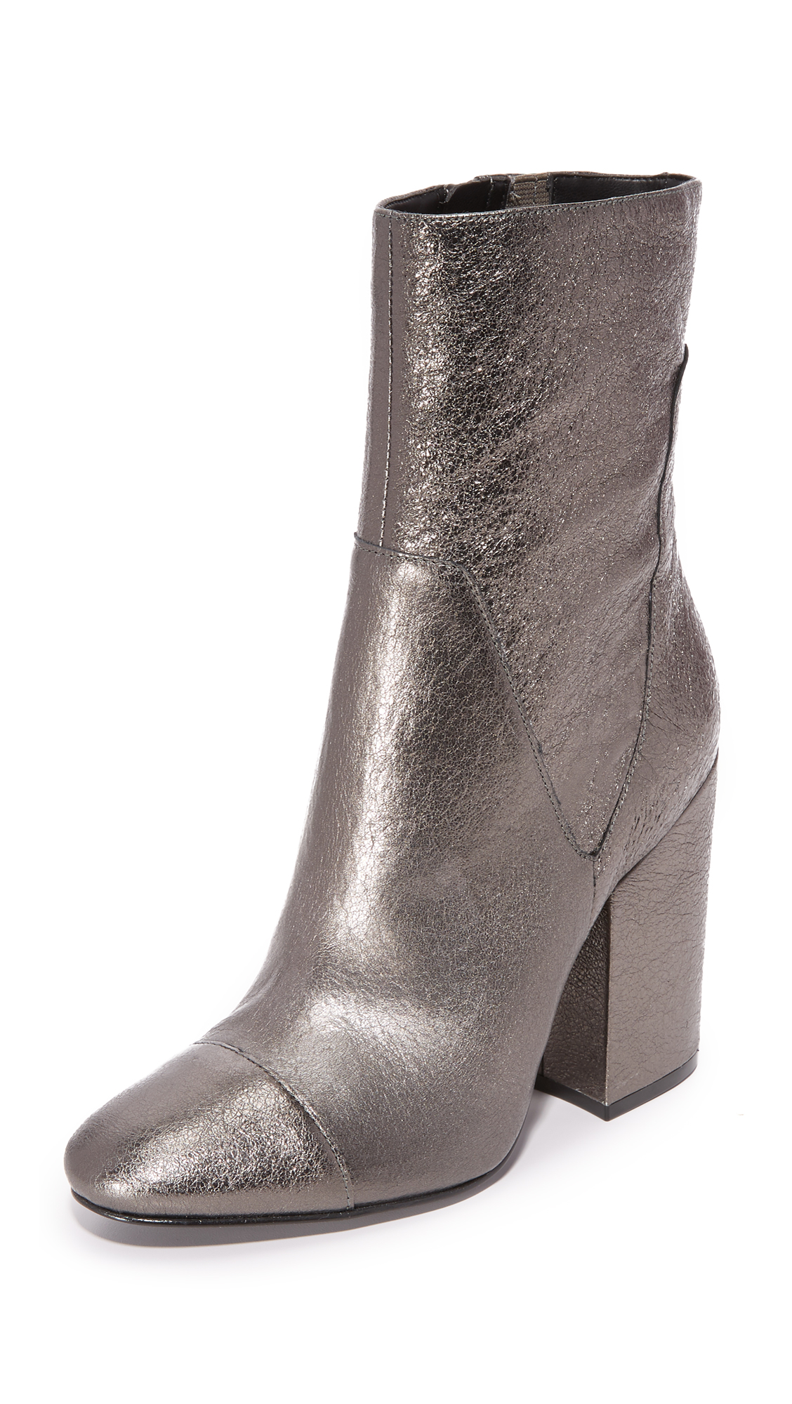 Panels of metallic leather compose these glamorous KENDALL + KYLIE booties. Inset elastic at the top line and exposed side zip. Chunky, covered heel and synthetic sole. Leather: Sheepskin. Imported, China. This item cannot be gift boxed.