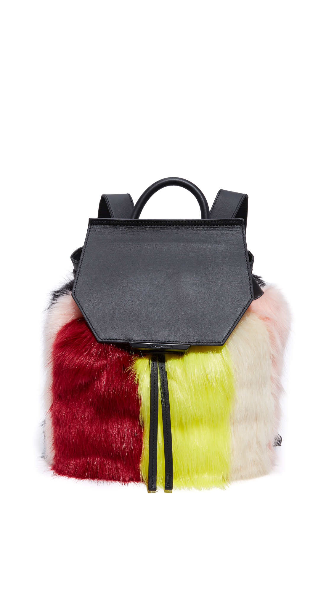 Colorful patches of faux fur cover this smooth leather KENDALL + KYLIE backpack. The push lock top flap covers a drawstring closure. Lined interior with 1 pocket. Locker loop and adjustable shoulder straps. Dust bag included. Leather: Cowhide.