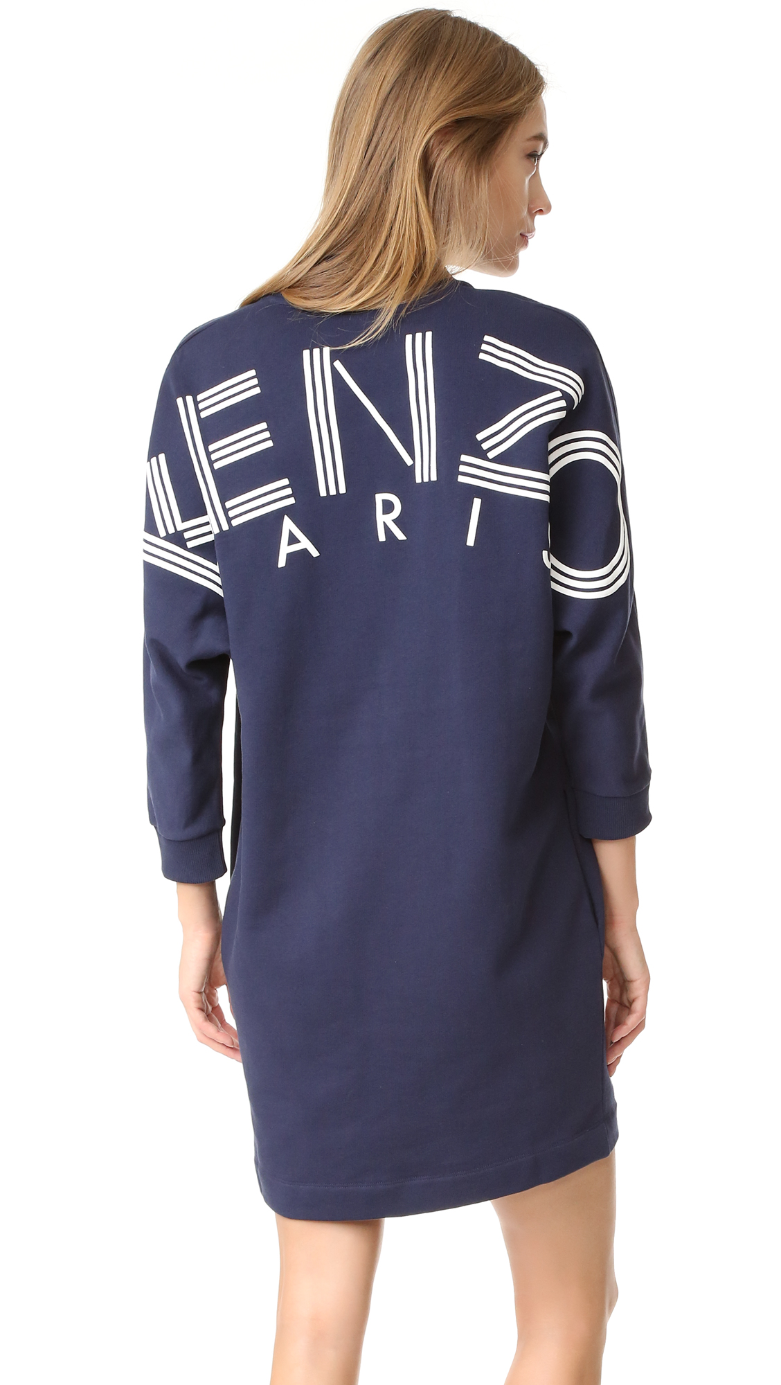 A casual KENZO dress with a ribbed V neckline and dolman sleeves. Oversized logo lettering across the back. Fabric: French terry. Shell: 100% cotton. Trim: 95% cotton/5% elastane. Wash cold. Made in Portugal. Measurements Length: 35.5in / 90cm, from