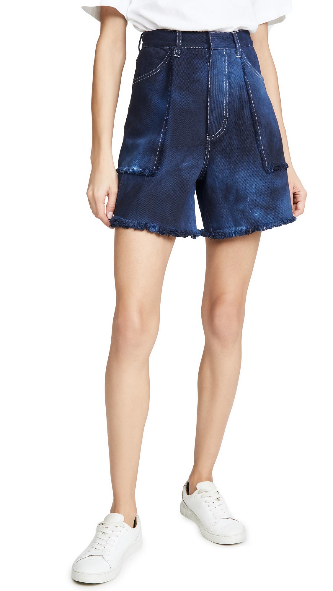 Buy Ksenia Schnaider online - photo of Ksenia Schnaider Denim Tie Dye Shorts