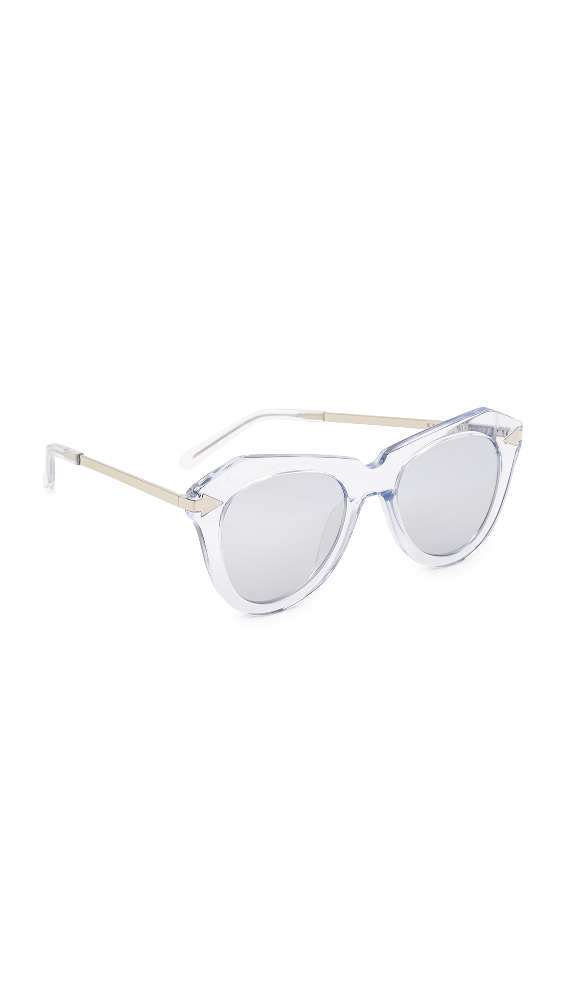 Glamorous Karen Walker sunglasses in angular, transparent frames. Wire arms. Mirrored lenses. Hard case and cleaning cloth included. Cateye frame. Non polarized lenses. Imported, China. Measurements Width: 5.5in / 14cm Height: 2.25in / 5.5cm Lens Width: 50mm. Available