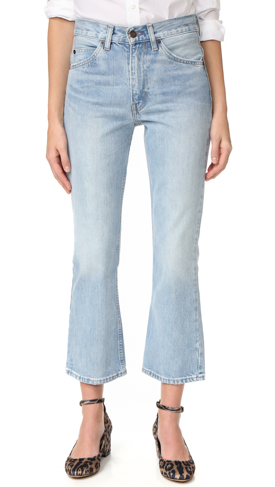 1960s inspired Levi's 517 boot cut jeans with heavy fading and a cropped profile. 5 pocket styling. Button closure and zip fly. Fabric: Denim. 100% cotton. Wash cold or dry clean. Imported, Turkey. Measurements Rise: 11in / 28cm Inseam: 26.75in / 68