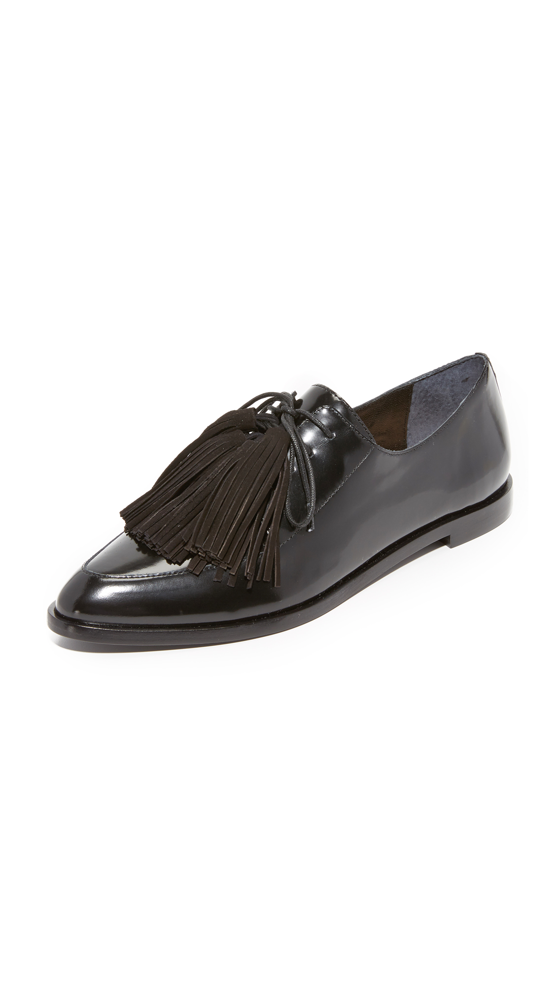 Classic leather oxfords, styled with a pointed toe and a highly polished finish. Optional tassels accent the tie closure. Leather sole. Leather: Cowhide. Imported, Brazil. This item cannot be gift boxed. Available sizes: 5,6,6.5,7,8,9