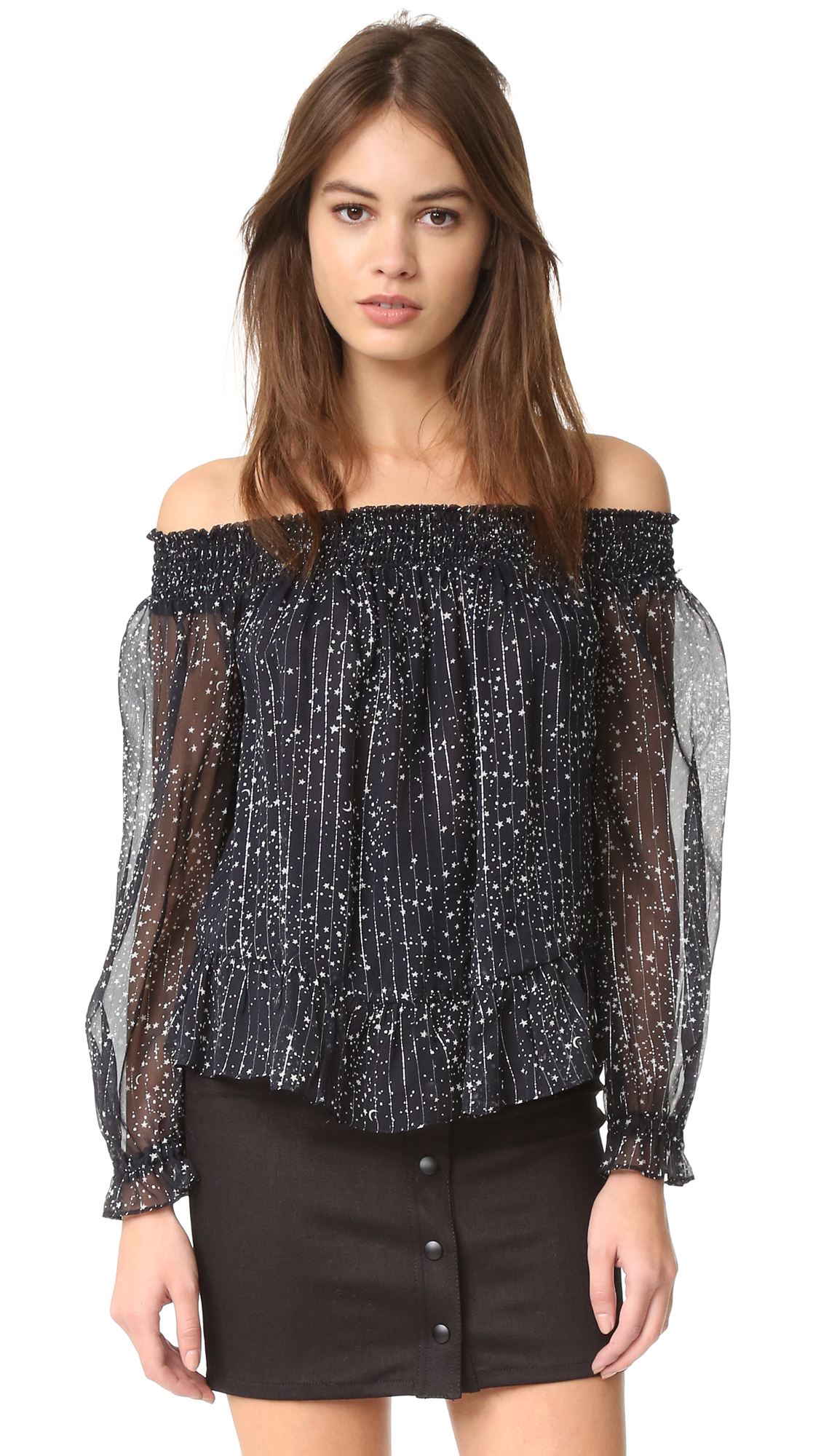 Metallic threads add a subtle glamour to this star print chiffon LOVESHACKFANCY off shoulder top. Ruffles accent the peplum hem and smocked elastic cuffs. Long sleeves. Partially lined. Semi sheer. Fabric: Silk chiffon. Shell: 100% silk. Lining: 100%