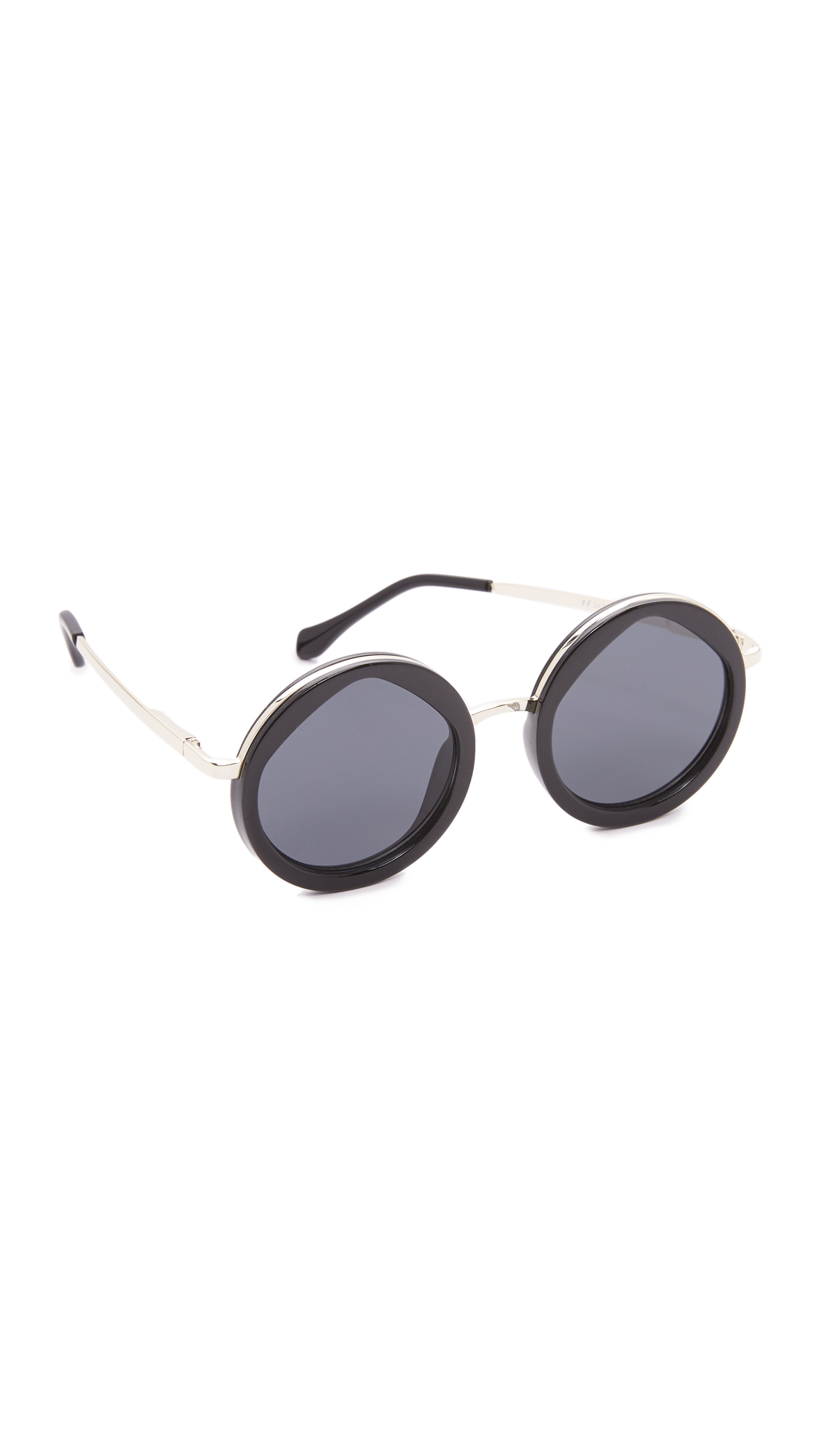 Thick, round frames and angular lenses give these Le Specs sunglasses a bold look. Wire trim. Soft case included. Round frame. Non polarized lenses. Imported, China. Measurements Width: 5.75in / 14.5cm Height: 2.25in / 5.75cm Lens Width: 49mm
