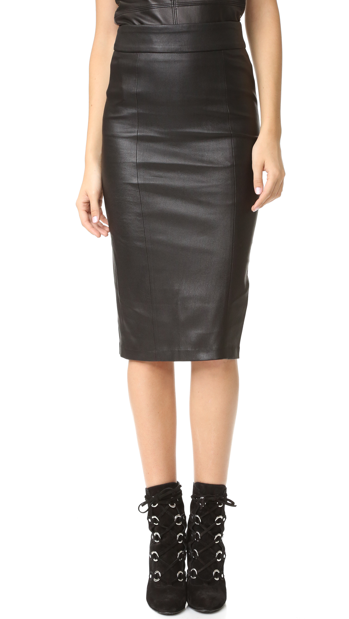 An edgy Mackage midi skirt in rich lambskin. Back zip closure. Slit in back. Fused weave interior. Fabric: Leather. 100% lambskin. Leather clean. Made in Canada. Measurements Length: 27.5in / 70cm Measurements from size $. Available sizes: 4