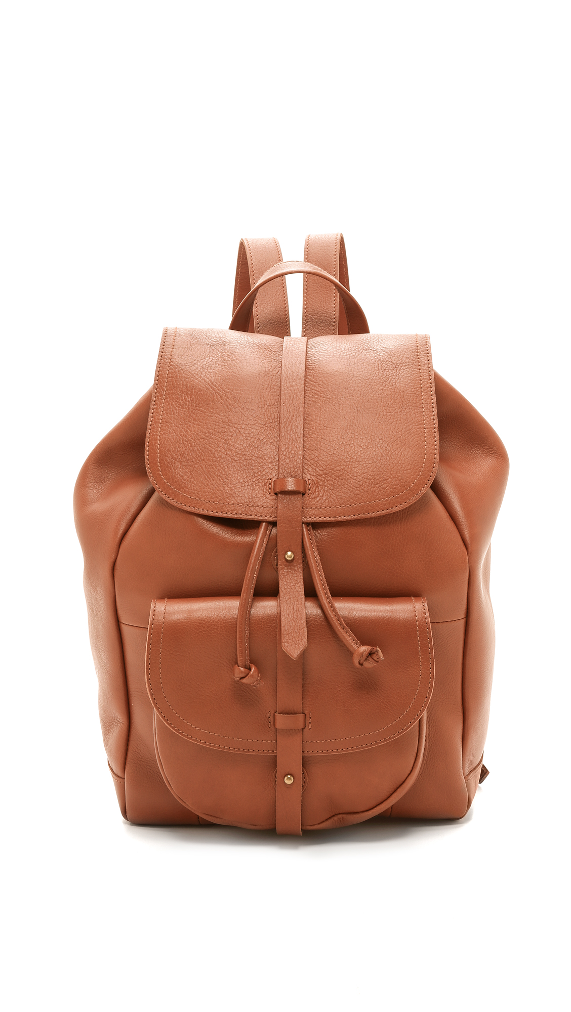 A large Madewell backpack rendered in sturdy leather. The top flap secures with a buttoned strap, and a flap pouch pocket outfits the front. Drawstring top and lined, 3 pocket interior. Adjustable shoulder straps. Leather: Cowhide. Weight: 40