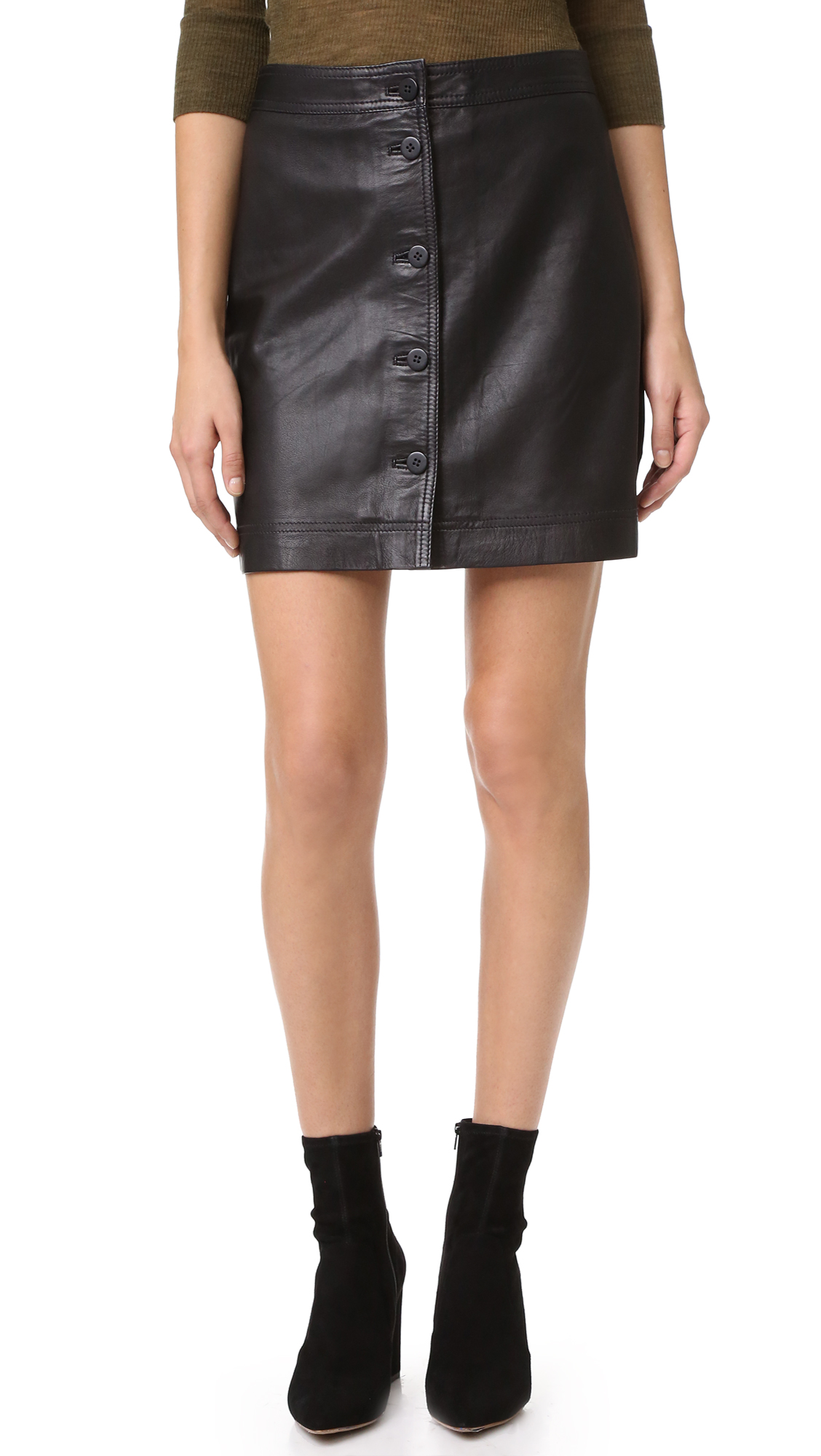 A supple leather Madewell miniskirt, styled with a full length, button front closure. Lined. Fabric: Leather. Shell: 100% lambskin. Lining: 100% polyester. Leather clean. Imported, India. Measurements Length: 17.25in / 44cm Measurements from size 4. Available sizes: 0