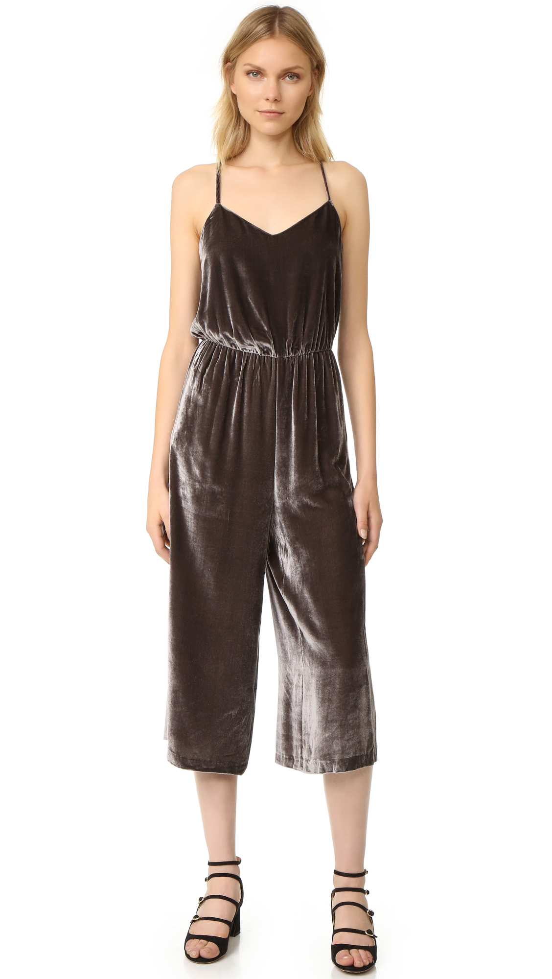 A slouchy Madewell jumpsuit in soft velvet. Gathered elastic waistband. On seam pockets. Adjustable shoulder straps. Hidden back zip. Lined. Fabric: Velvet. Shell: 82% viscose/18% silk. Lining: 100% polyester. Dry clean. Imported, China. Measurements Inseam: 20.75in / 53cm Leg