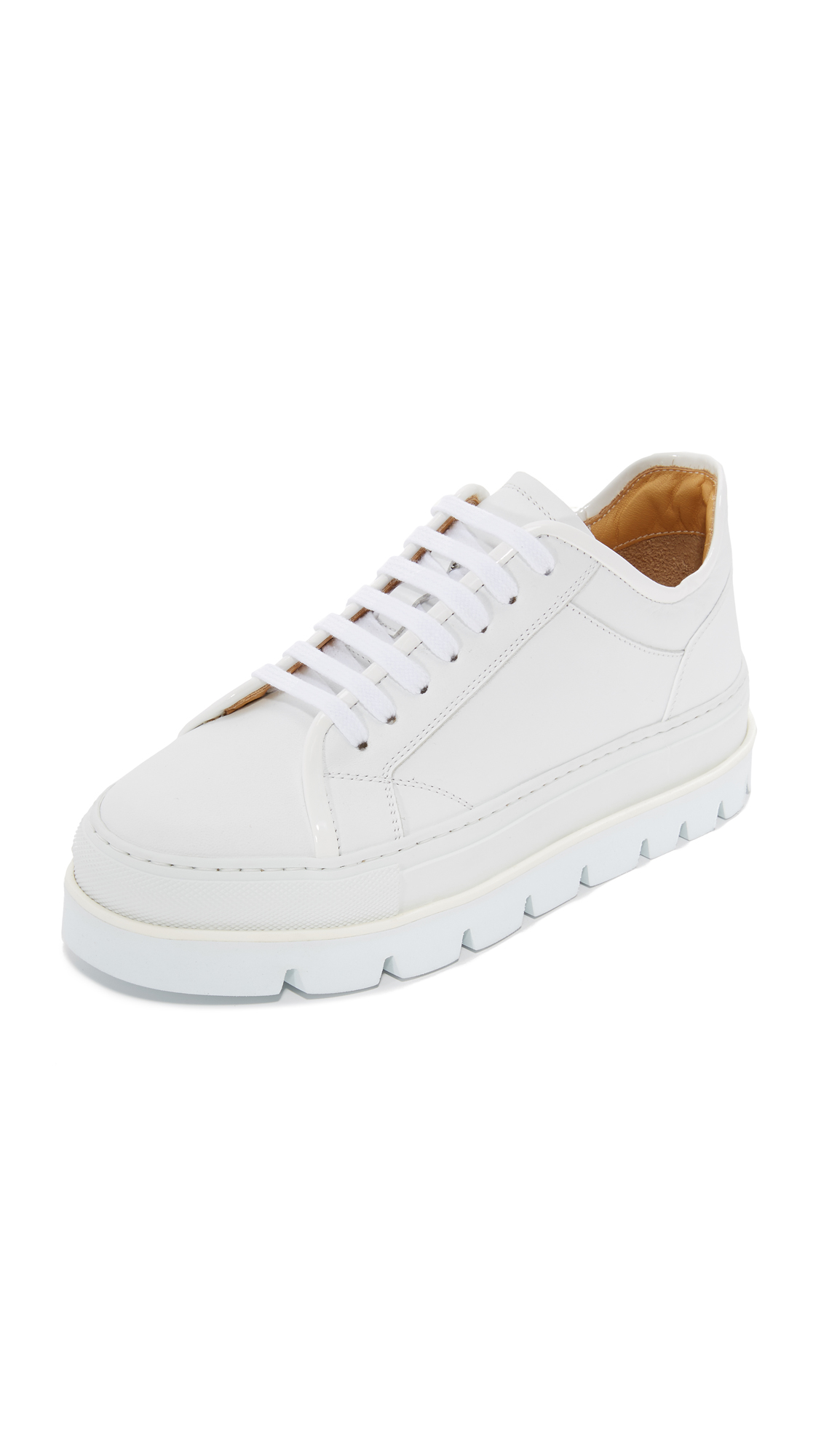 A tiered platform made of foam and rubber adds a substantial lift to these sturdy leather MM6 sneakers. Patent trim at the top line. Lace up closure. Rubber sole. Leather: Calfskin. Made in Italy. This item