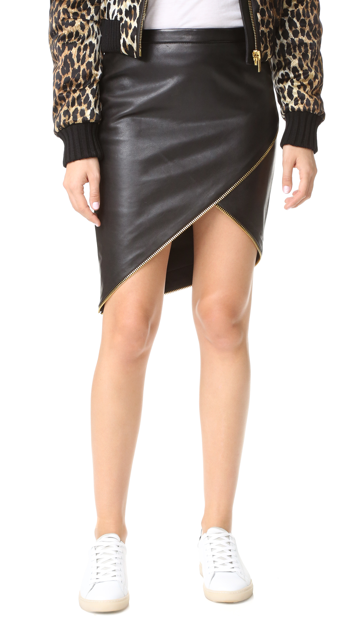 Zipper accents give this Michelle Mason skirt an edgy aesthetic. Asymmetric hem. Back zip. Lined. Fabric: Leather. Shell: 100% lambskin. Lining: 100% polyester. Leather clean. Imported, India. Measurements Length 1: 12.5in / 32cm, to shortest point Length 2: 22.5in / 57cm, to