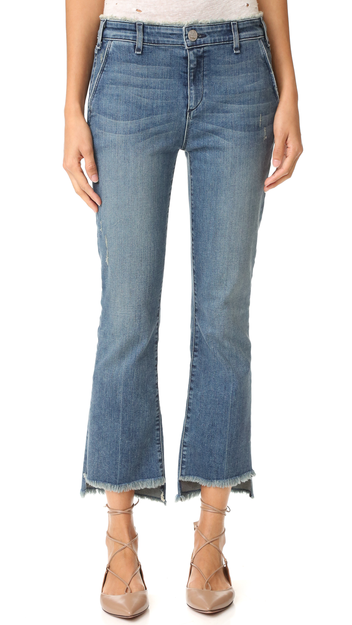 Scattered shreds and allover fading give these cropped McGuire Denim jeans an undone look. Frayed edges. 4 pockets. Button closure and zip fly. Fabric: Lightweight stretch denim. 92% cotton/6% elastomultiester polyester/2% elastane. Wash cold. Made in the USA.