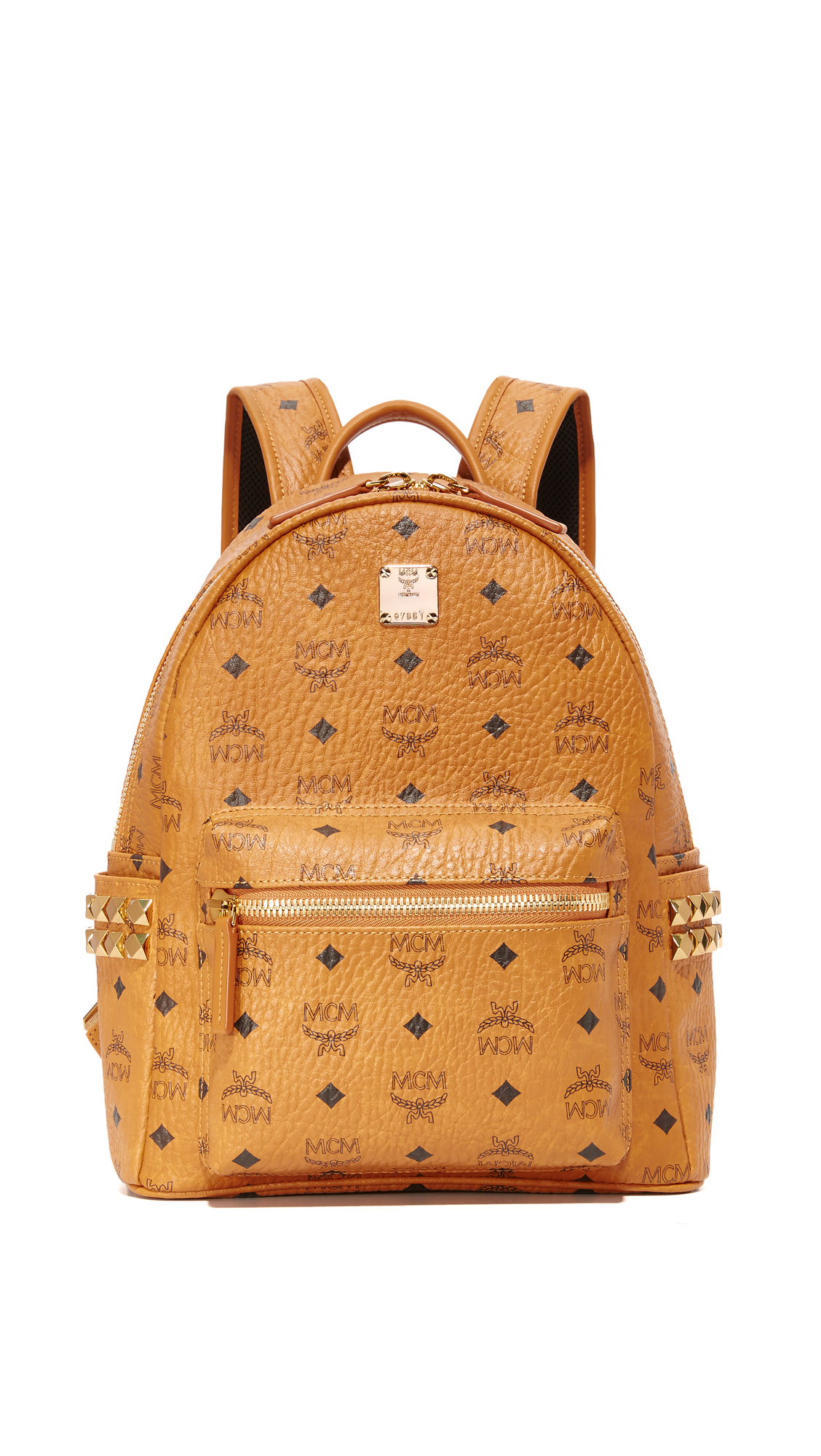 Polished studs detail the sides of this monogrammed MCM backpack. 3 exterior pockets. Wraparound top zip and leather lined, 2 pocket interior. Locker loop and adjustable shoulder straps. Dust bag included. Fabric: Coated canvas. Weight: 30oz / 0.85kg. Imported,