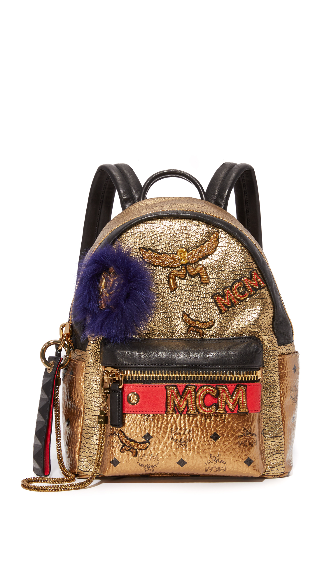 Embroidered logo lettering and tonal fur detail this wrinkled leather MCM backpack. Zip front pocket and 2 side pockets. Wraparound top zip and twill lined, 1 pocket interior. Locker loop and adjustable shoulder straps. Dust bag included. Fur: