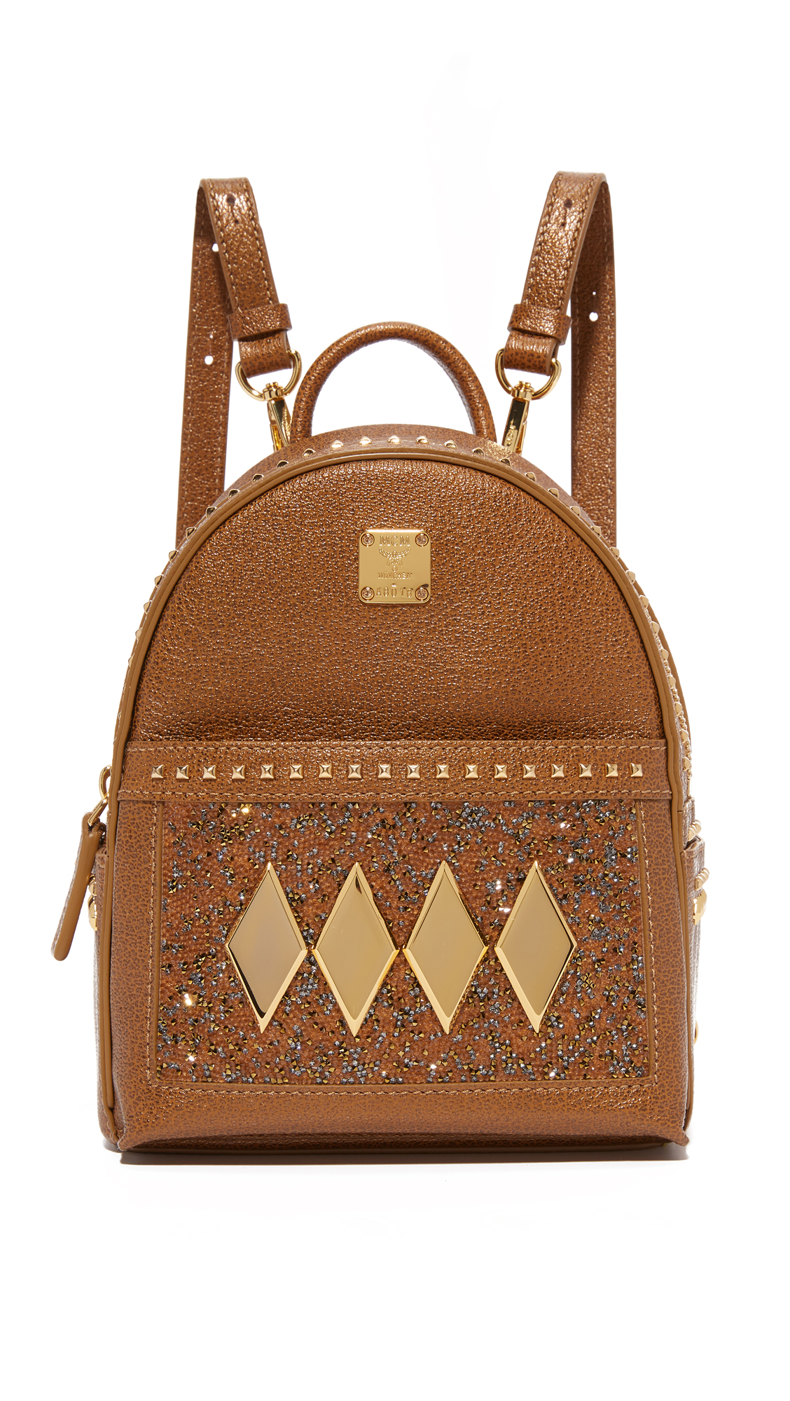 This petite MCM backpack is embellished with rows of polished studs, sparkles, and the brand's logo plate. A zip front pocket and patch side pockets provide extra storage. The top zip opens to a lined interior