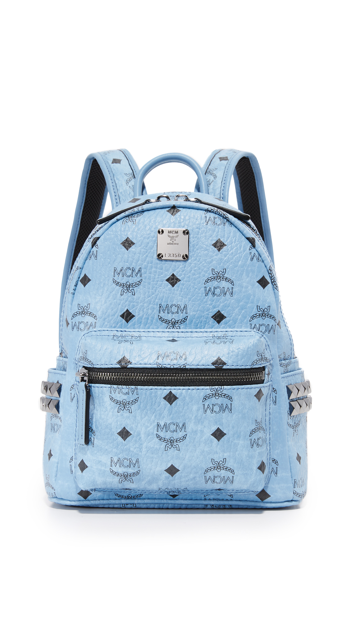 A scaled down MCM backpack in leather like coated canvas with the brand's monogram. Zip front pocket and slim side pockets. Wraparound top zip and leather lined, 1 pocket interior. Locker loop and adjustable shoulder straps. Dust