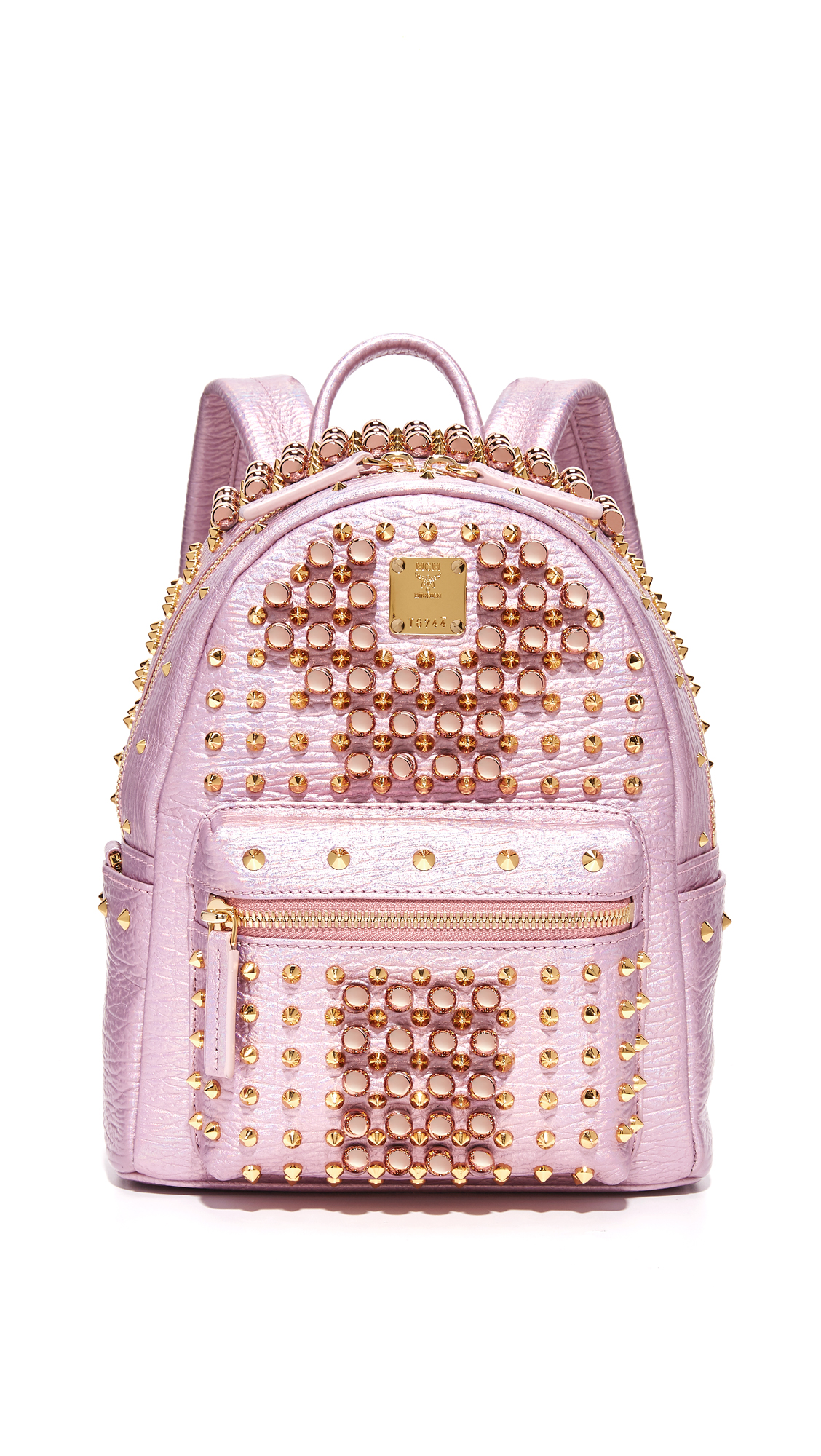 A statement making MCM backpack with mixed metal studs. Zip front pocket and slim side pockets. Wraparound top zip and leather lined, 1 pocket interior. Locker loop and adjustable shoulder straps. Dust bag included. Leather: Cowhide. Weight: 20
