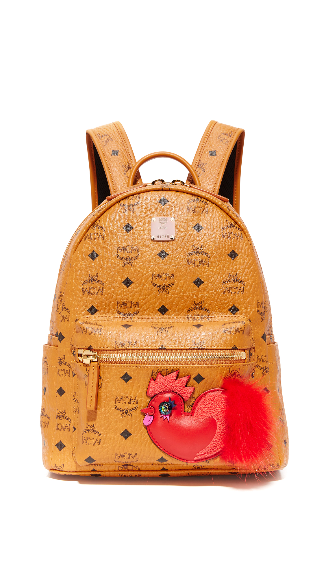 Part of the brand's New Year series, a monogrammed MCM backpack detailed with fur trimmed rooster appliqué. Zip front pocket and slim side pockets. Wraparound top zip and lined, 1 pocket interior. Locker loop and optional, adjustable