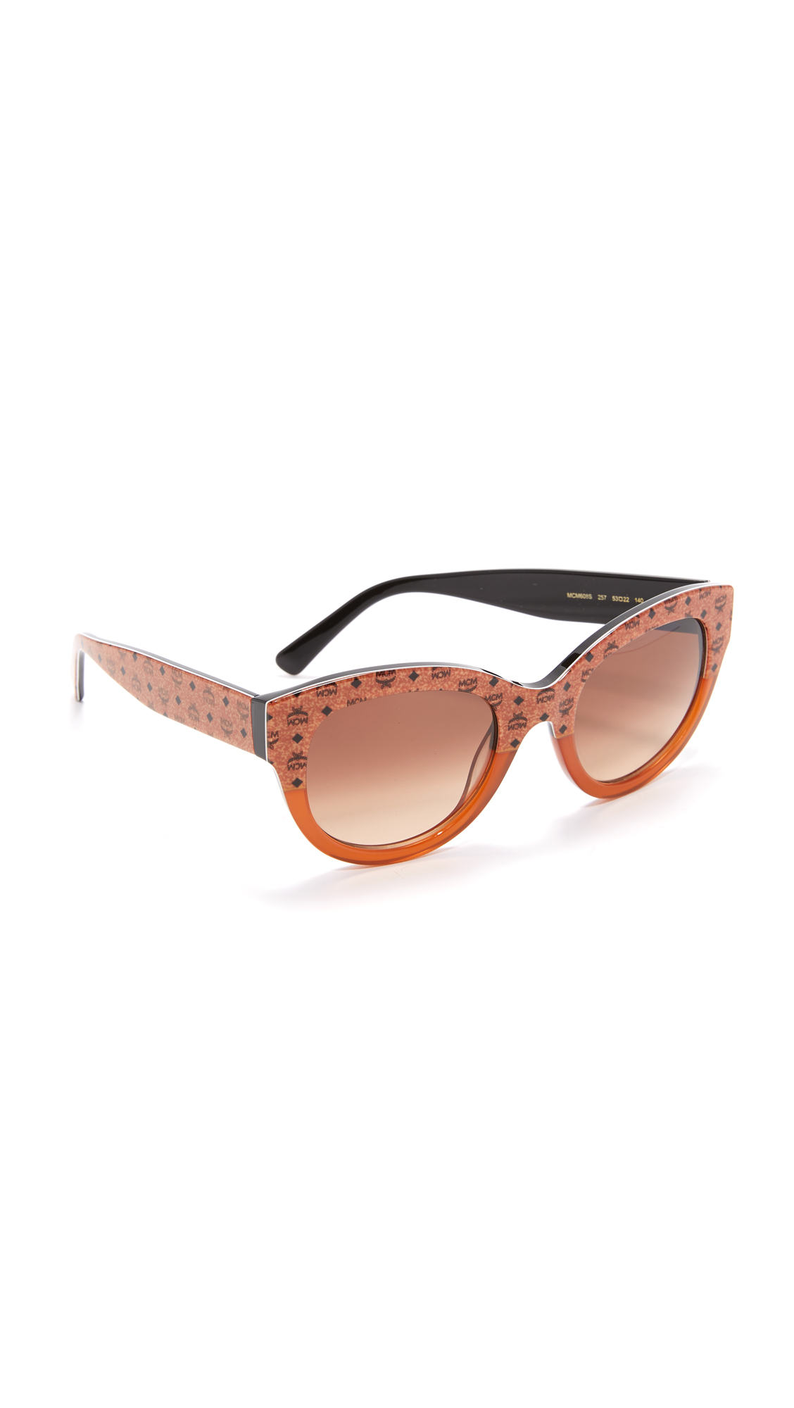 Transparent sections detail these cat eye MCM sunglasses. Hard case and cleaning cloth included. Cateye frame. Non polarized lenses. Made in Italy. Measurements Width: 5.5in / 14cm Height: 2.25in / 5.5cm Lens Width: 53mm. Available sizes: One Size