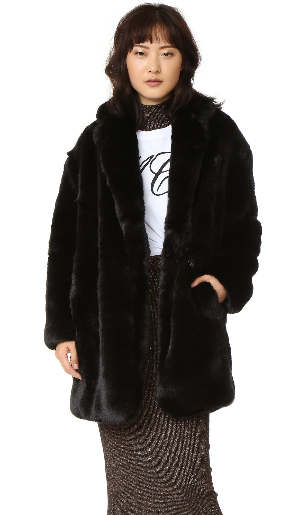 An oversized McQ   Alexander McQueen coat in plush faux fur. Shawl lapels join at the hook and eye placket. 2 pockets. Long sleeves. Lined. Fabric: Faux fur. Shell: 70% acrylic/18% modacrylic/12% polyester. Lining: 100% polyester. Dry clean. Imported, China.