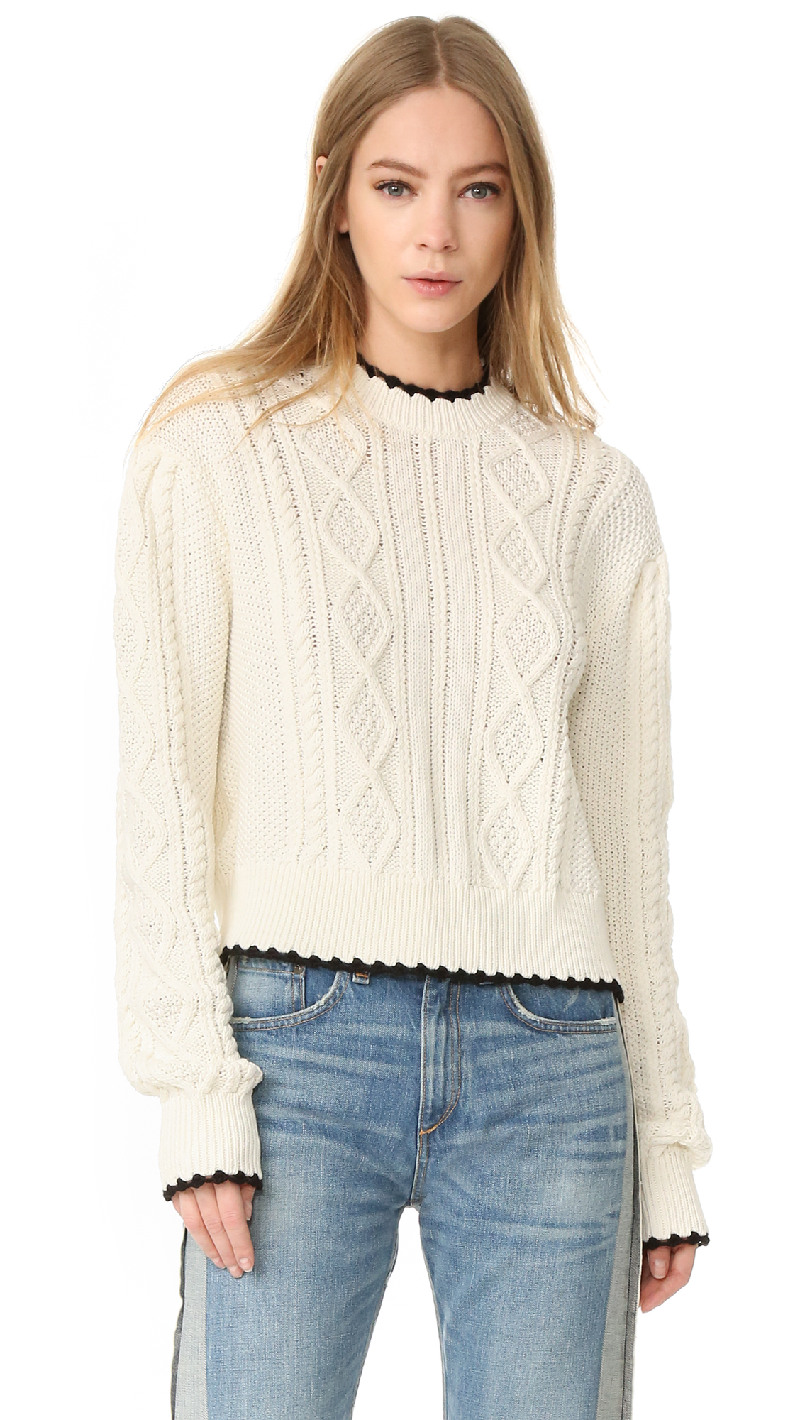 Contrast, scalloped trim accents the edges of this cable knit McQ   Alexander McQueen sweater. A button back keyhole secures the high neckline. Ribbed edges. Long sleeves. Fabric: Knit. Shell: 100% cotton. Trim: 100% wool. Hand wash or dry