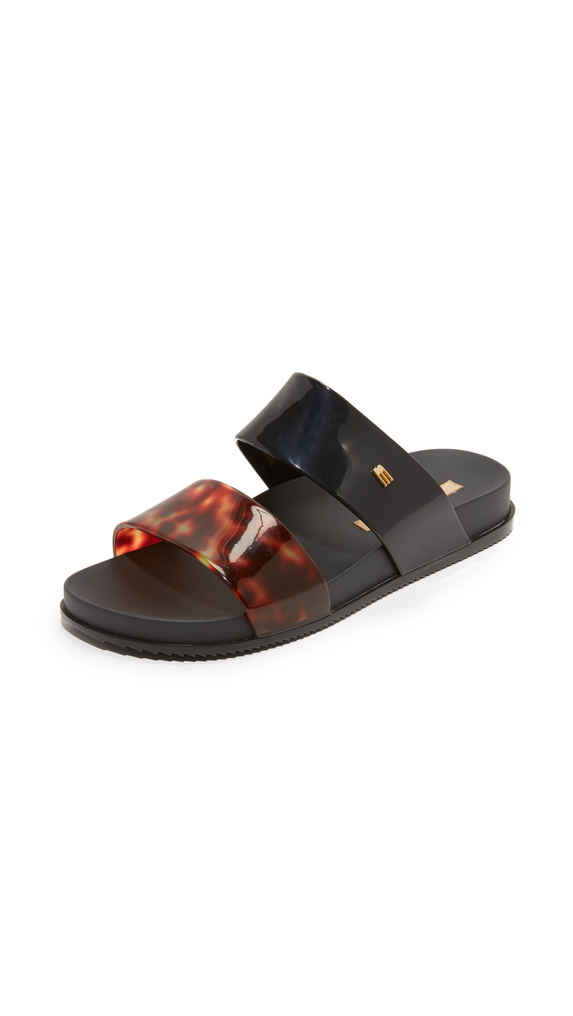 Casual Melissa slide sandals in a two strap silhouette. Inset molded footbed and ridged rubber sole. Fabric: PVC. Imported, Brazil. This item cannot be gift boxed. Available sizes: 5,6