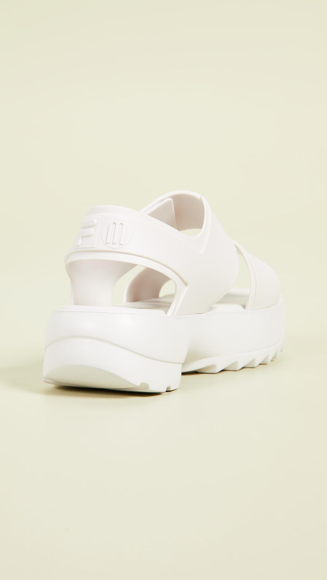 17e28c78855b Melissa x Fila Sandals