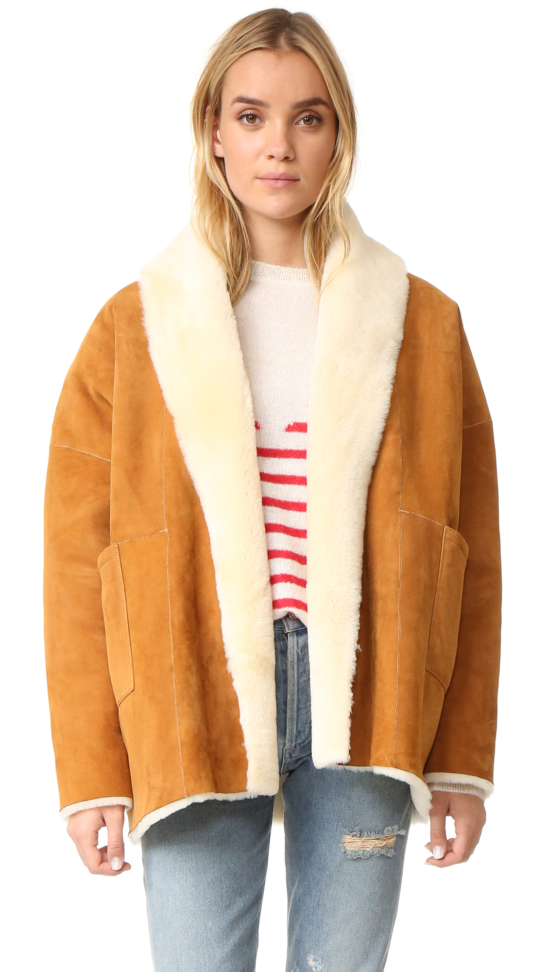 A cozy, reversible Mes Demoiselles coat with luxe suede on one side and plush shearling on the reverse. Two hip pockets at each side. Open placket. Fur: Natural sheep shearling, from Turkey. Fur clean. Imported, Turkey.