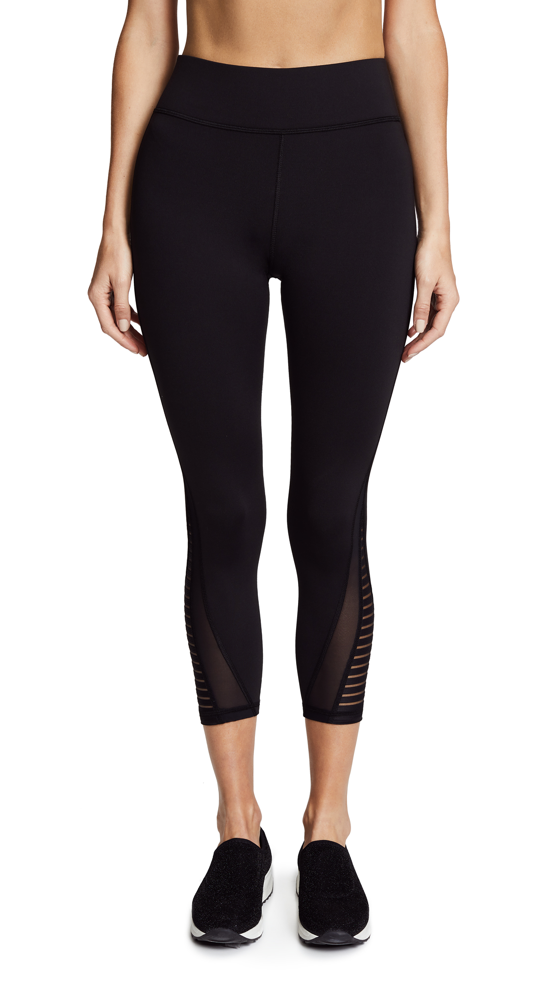 Cropped MICHI leggings with striped mesh gussets for easy movement. A wide elastic waist provides a comfortable fit. Overlock seams. Fabric: Activewear jersey. 88% nylon/12% spandex. Wash cold. Made in Canada. Measurements Rise: 9.75in / 25cm Inseam: 22in / 56cm Measurements from size S