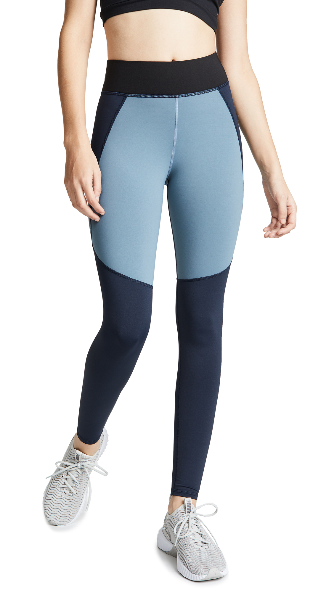 Fabric: Athletic jersey Contrast paneling Leggings Cropped profile Covered elastic at waist Shell: 88% nylon/12% spandex Wash cold Made in Canada Measurements Measurements from size S Rise: 9in / 23cm Inseam: 24in / 61cm Leg opening: 7.75in / 20cm