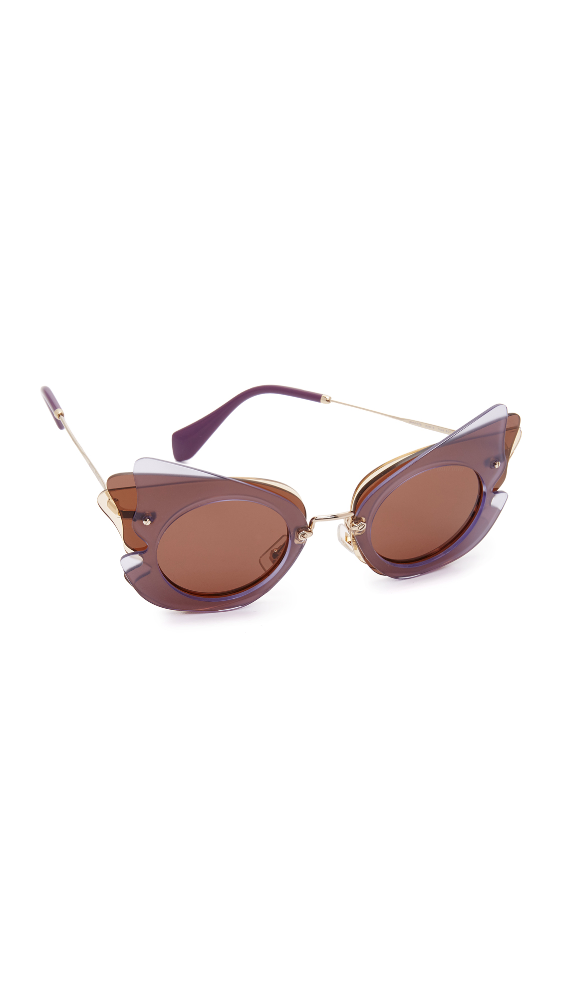 Overlapping lenses create a layered, butterfly inspired effect on these daring Miu Miu sunglasses. Slim arms. Soft pouch, hard case, and cleaning cloth included. Cateye frame. Non polarized lenses. Made in Italy. Measurements Width: 6in / 15.5cm