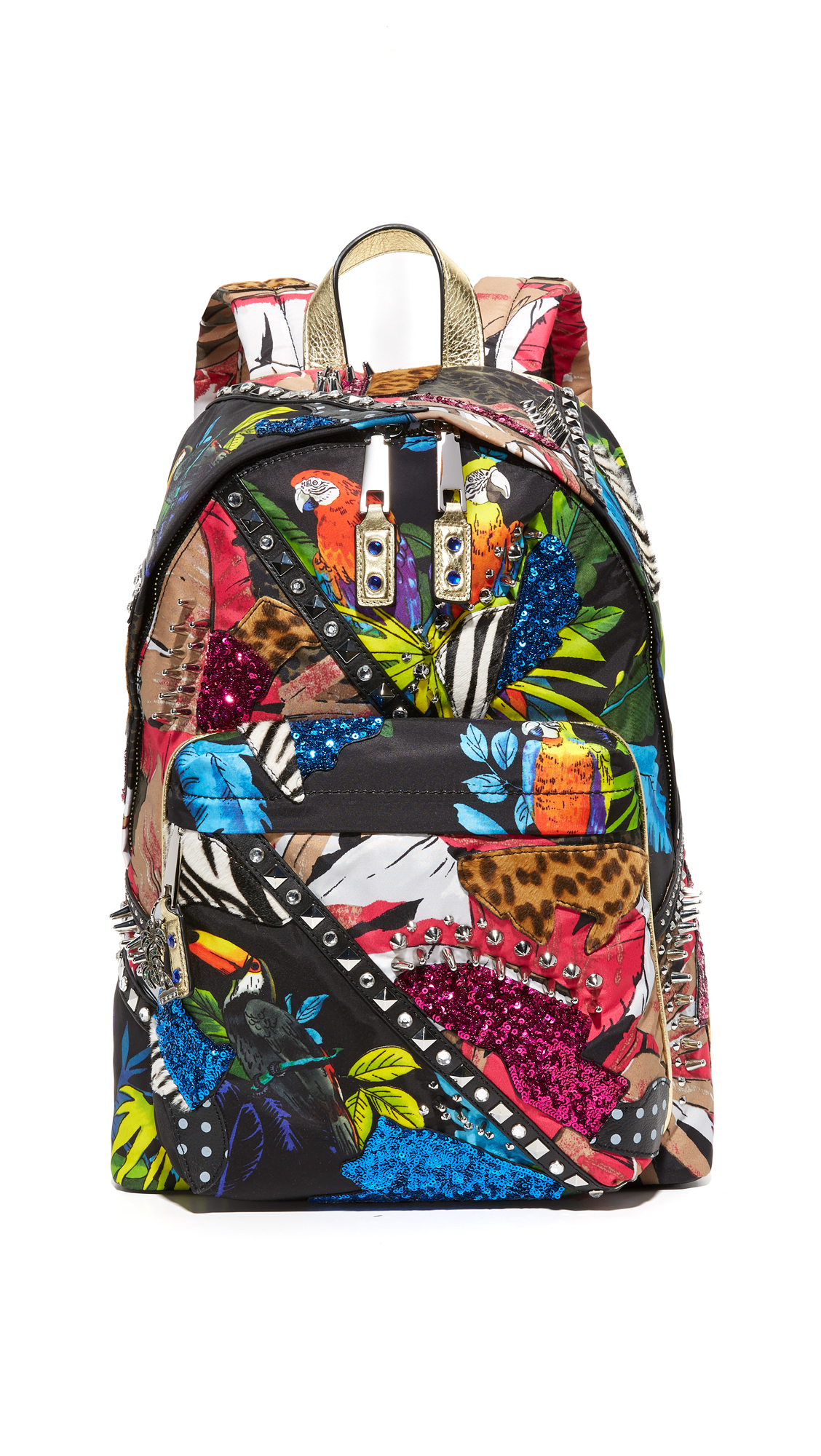 This printed Marc Jacobs backpack is detailed with an attention grabbing mix of leather, haircalf, and sequined panels. Rows of crystals and studs complete the bold look. Zip front pocket. Wraparound top zip and lined, 1 pocket