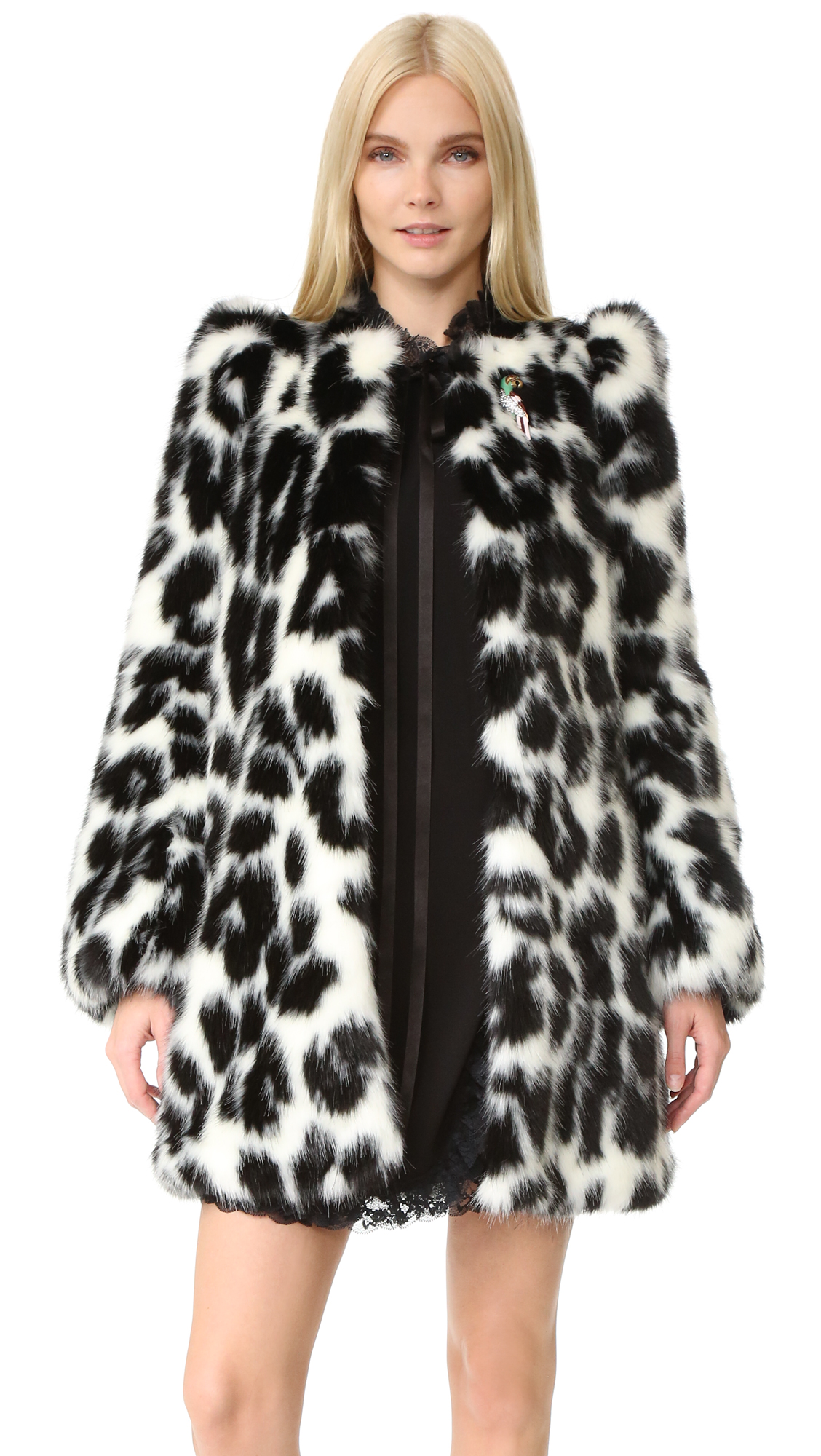 This Marc Jacobs coat makes a daring statement in spotted faux fur. A parrot shaped brooch adds a playful, vintage inspired detail. Hook and eye closures and on seam pockets. Long sleeves. Lined. Fabric: Faux fur.