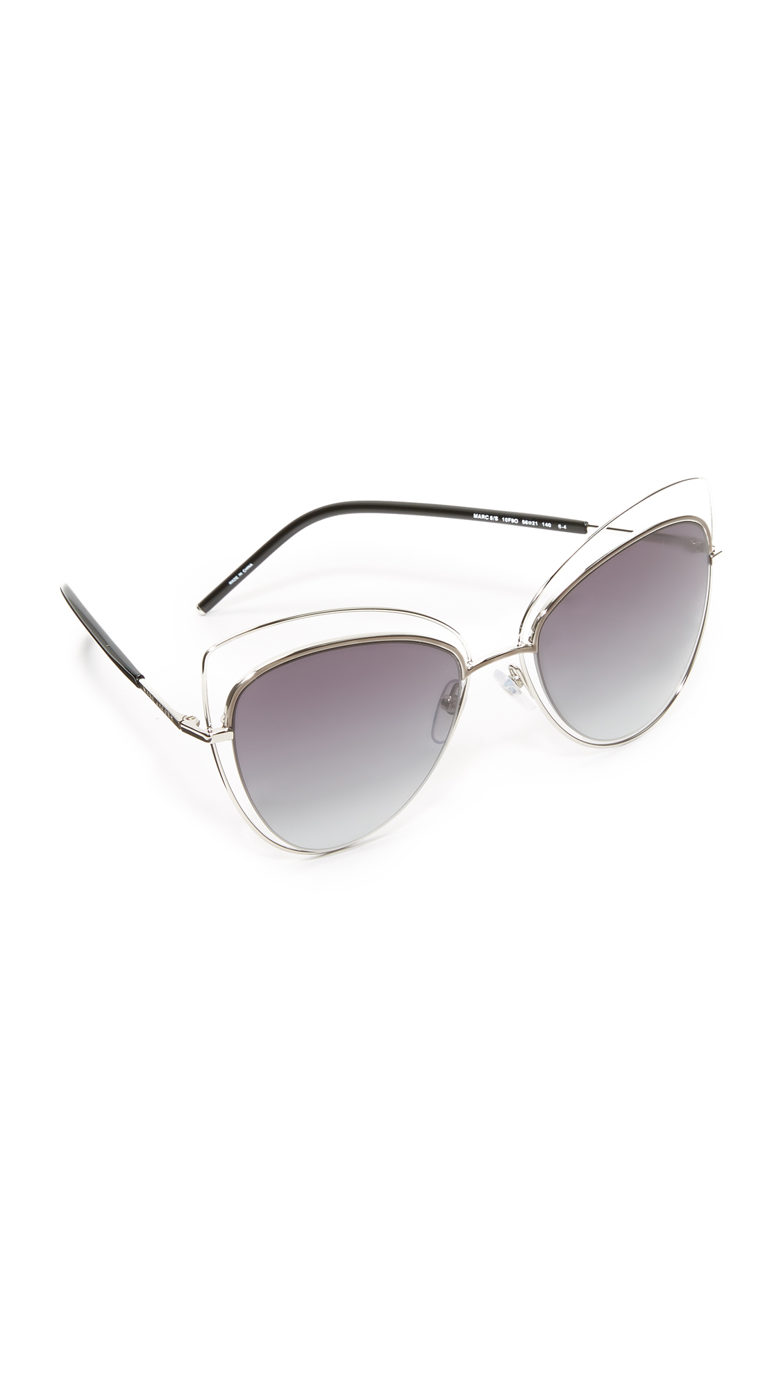 Cat eye Marc Jacobs sunglasses, updated with a second metal rim. Gradient lenses and sleek, metal tipped arms. Hard case and cleaning cloth included. Cateye frame. Non polarized lenses. Imported, China. Measurements Width: 5.5in / 14cm Height: 2.25