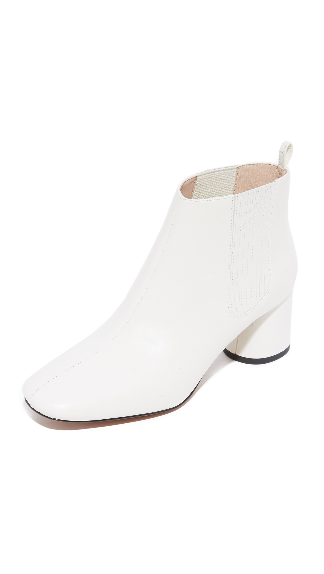 Sophisticated Marc Jacobs chelsea booties in bright leather. Hidden elastic insets at the sides and a pull tab at the top line. Covered, round heel with rubber patch. Leather sole. Leather: Calfskin. Imported, China. Measurements Heel: 2.25