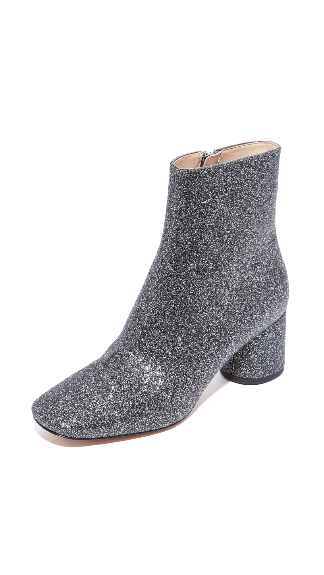 Shimmering glitter covers these glamorous Marc Jacobs booties. Exposed side zip. Covered, round heel. Leather sole. Fabric: Glitter coated weave. Imported, China. Measurements Heel: 2.25in / 55mm Shaft: 5.5in / 14cm Circumference: 9.5in / 24cm. Available sizes: 35.5,36,36.5,37,37.5,38,38.5,39,39.5,40