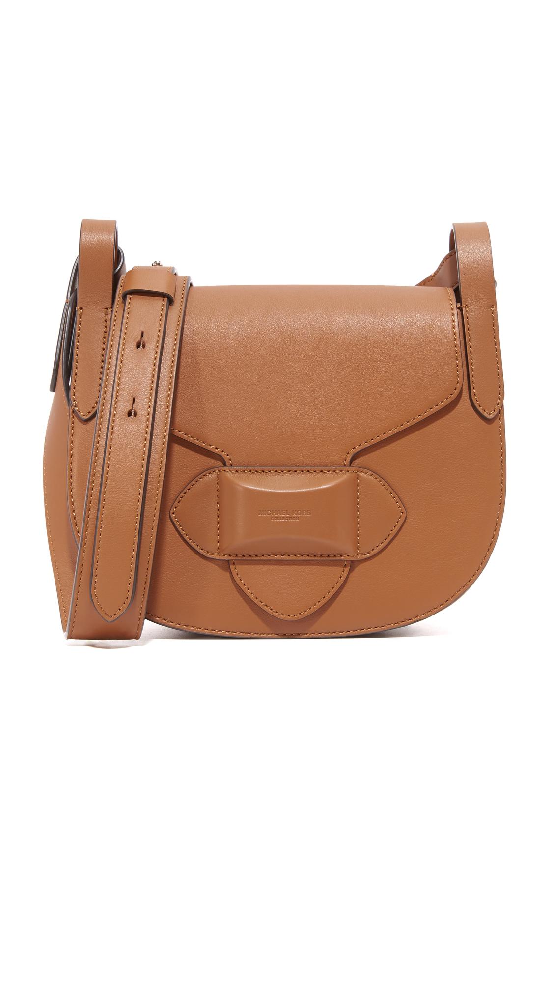 michael kors female  michael kors collection daria small cross body saddle bag luggage